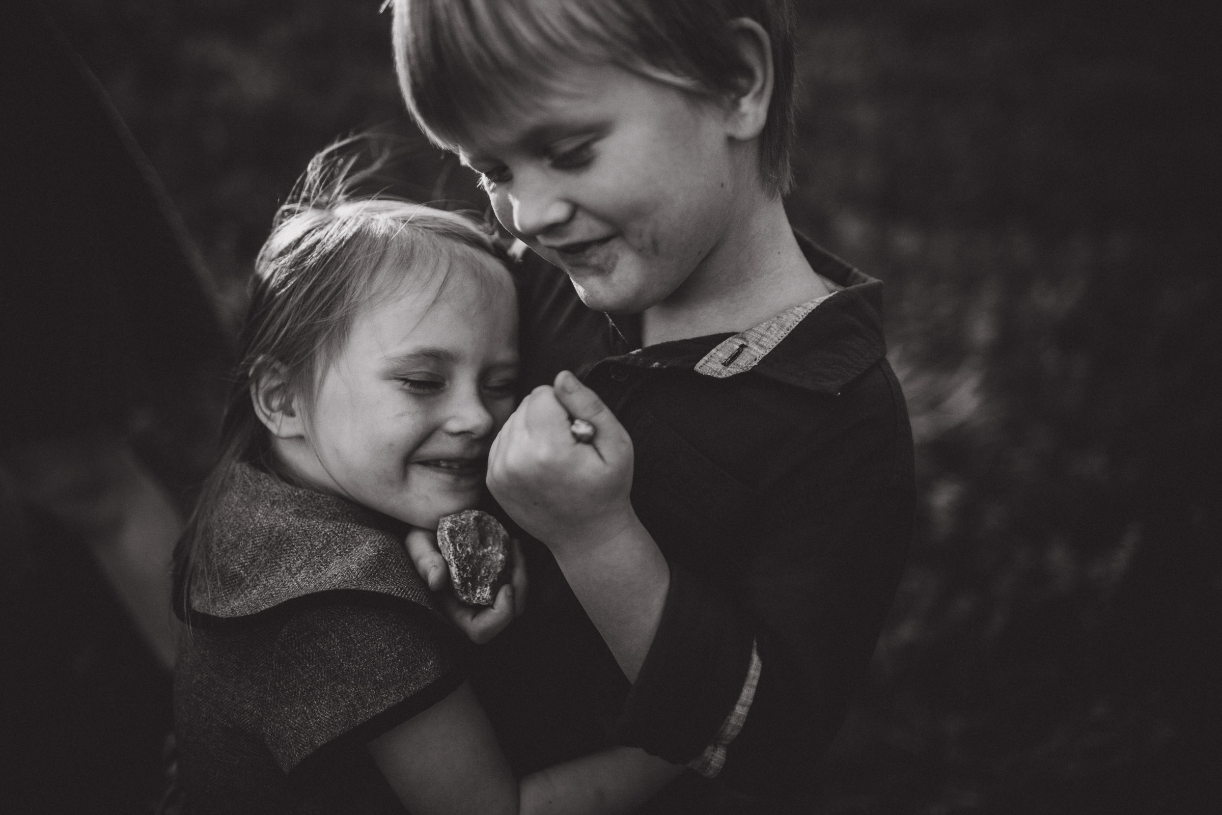 black and white portrait of brother and sister together