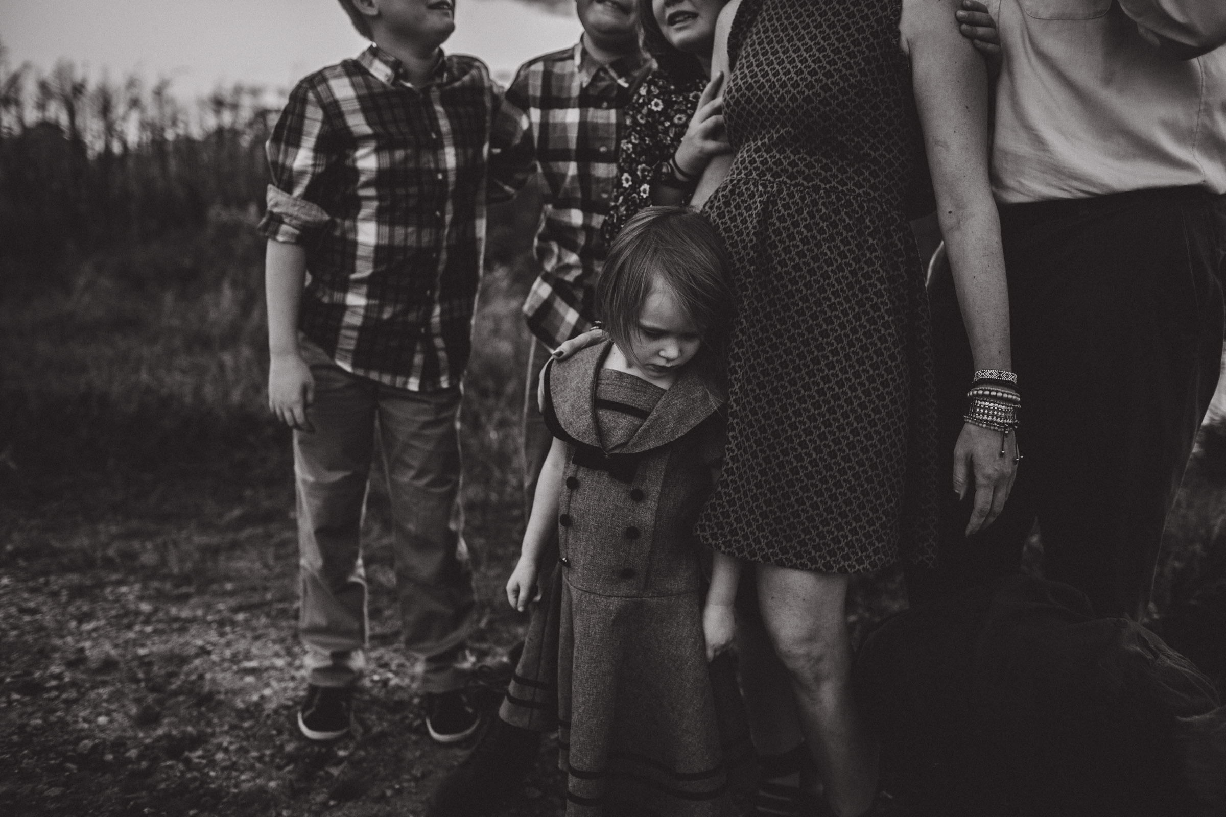 documentary style black and white image of family together