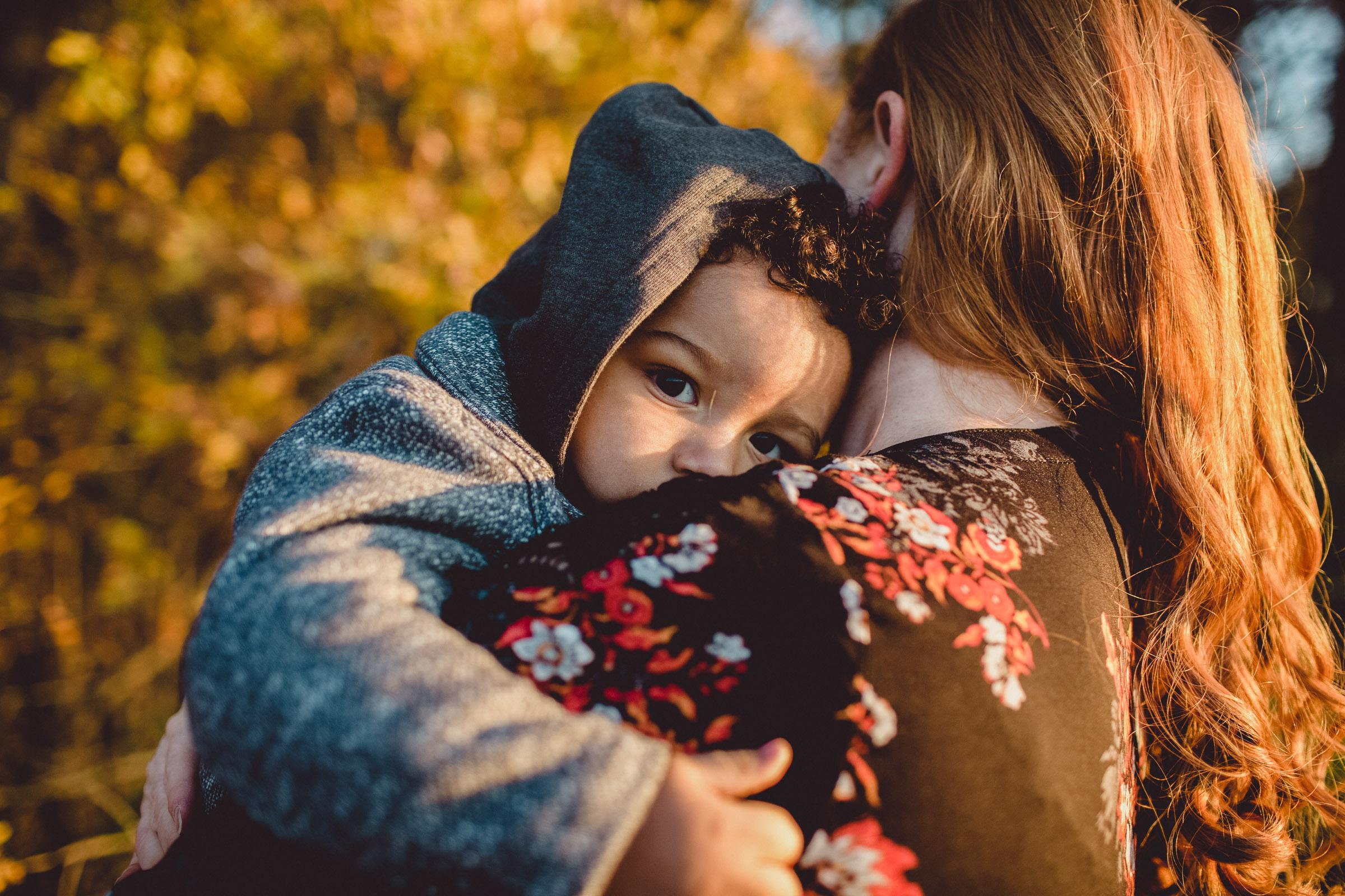child resting on mother's shoulder