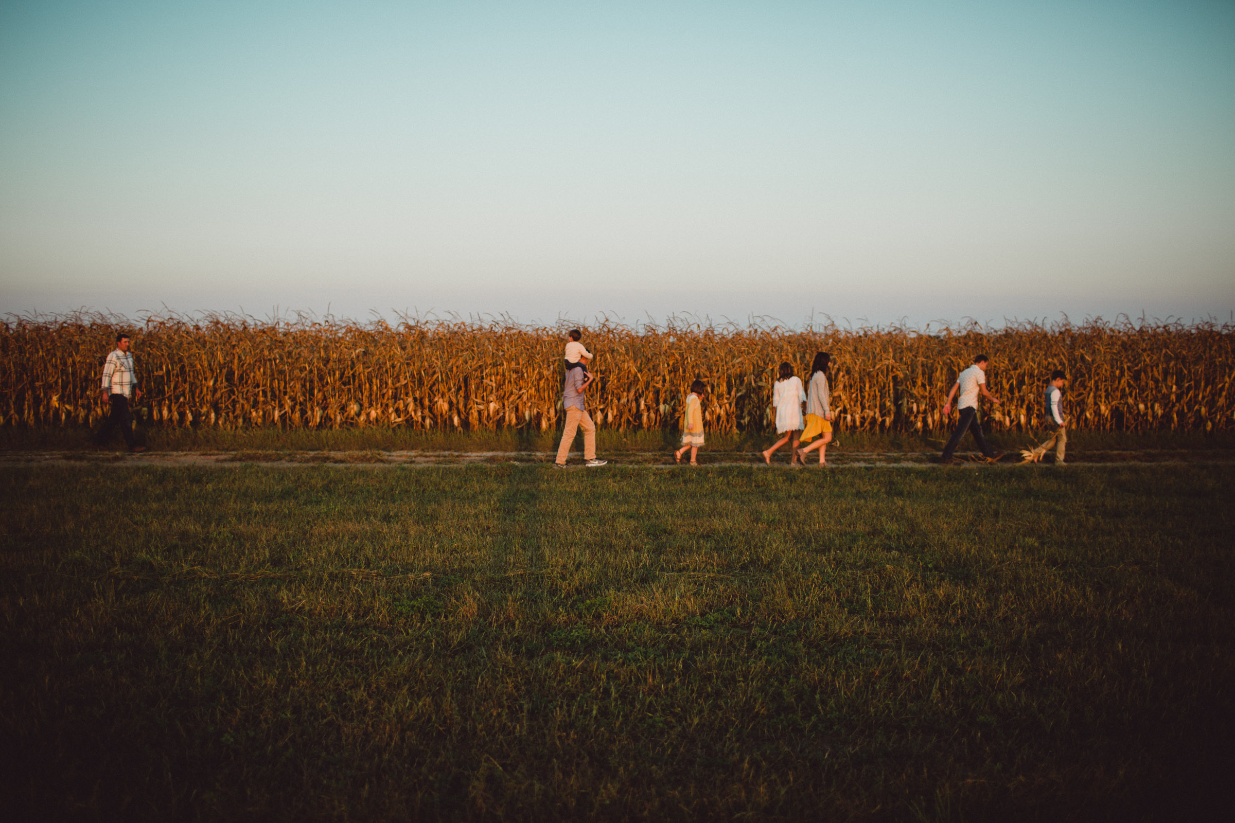 Family walking along a field together