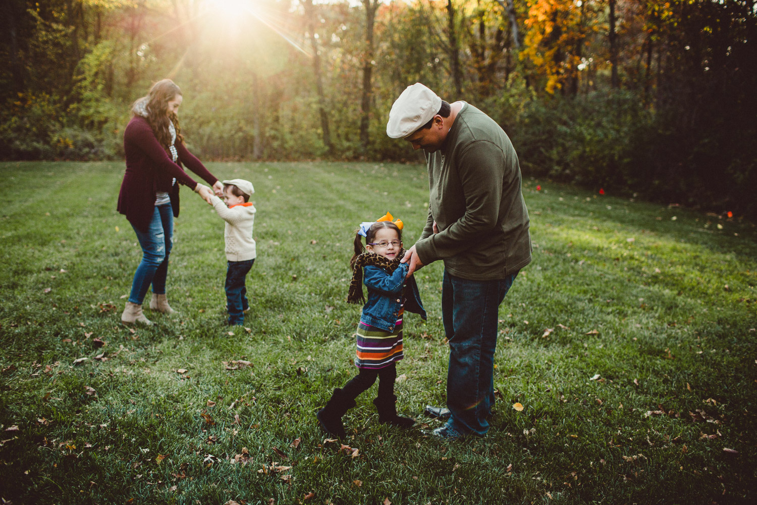 Family dancing together in wide open field