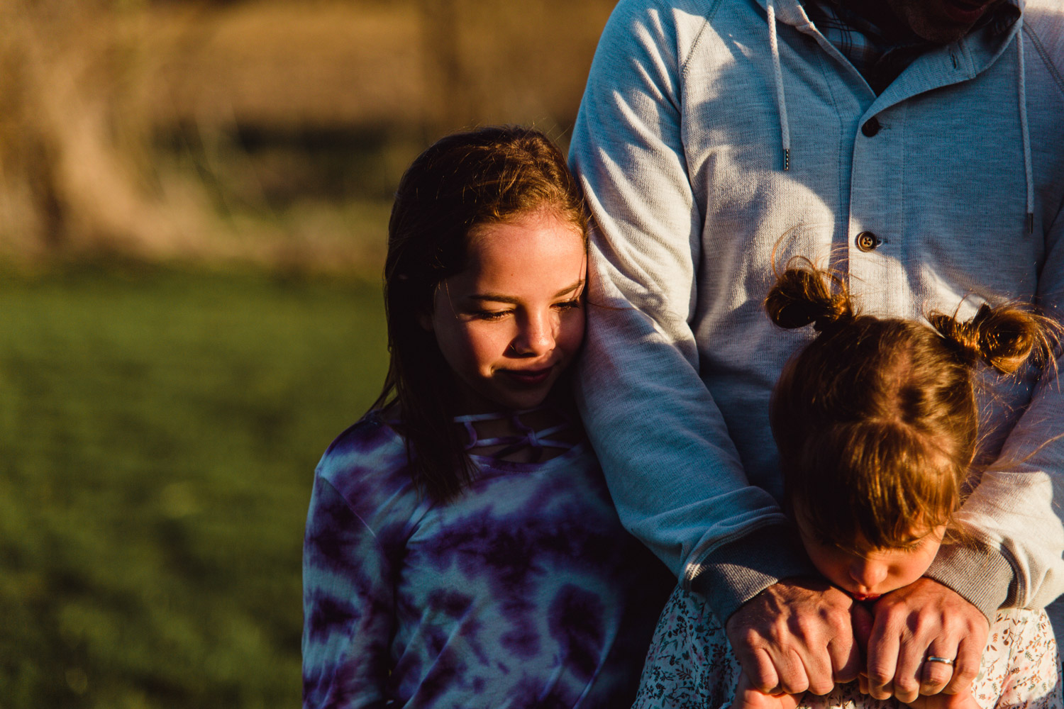 daughter firmly grasping fathers hands