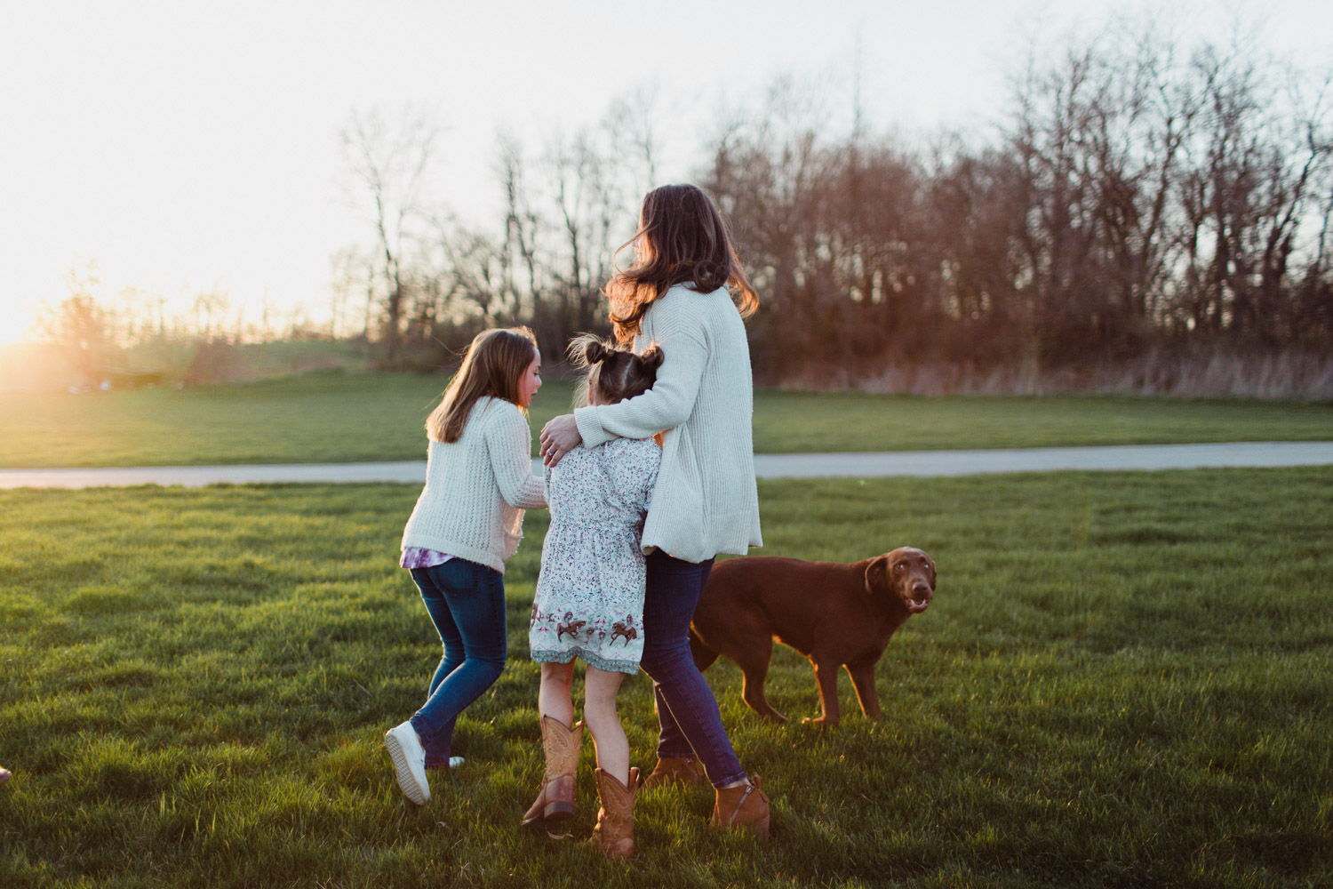 family gathered together with dog