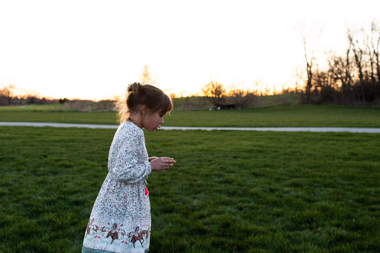 Girl walking along field