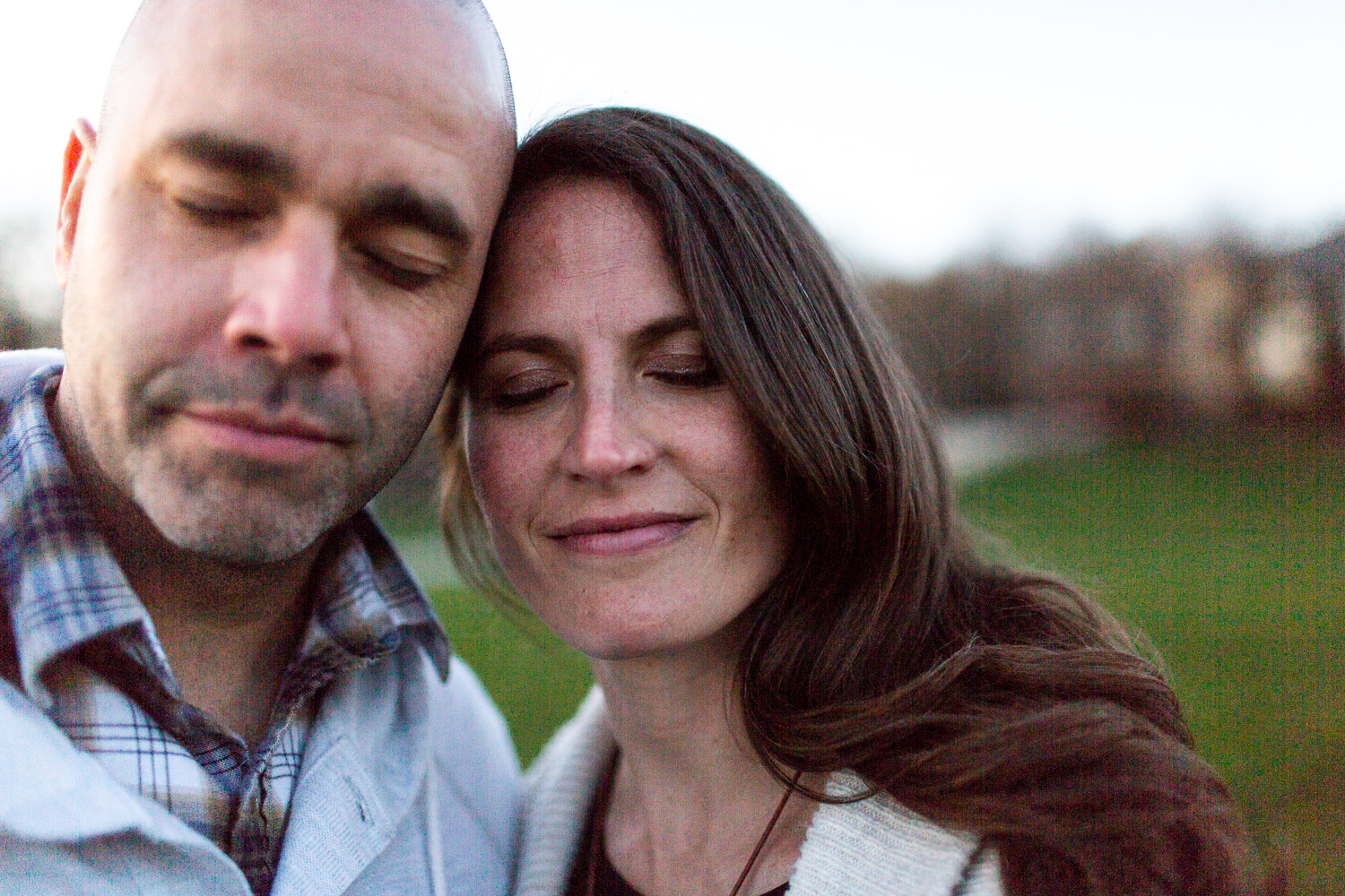 Couple with eyes closed together