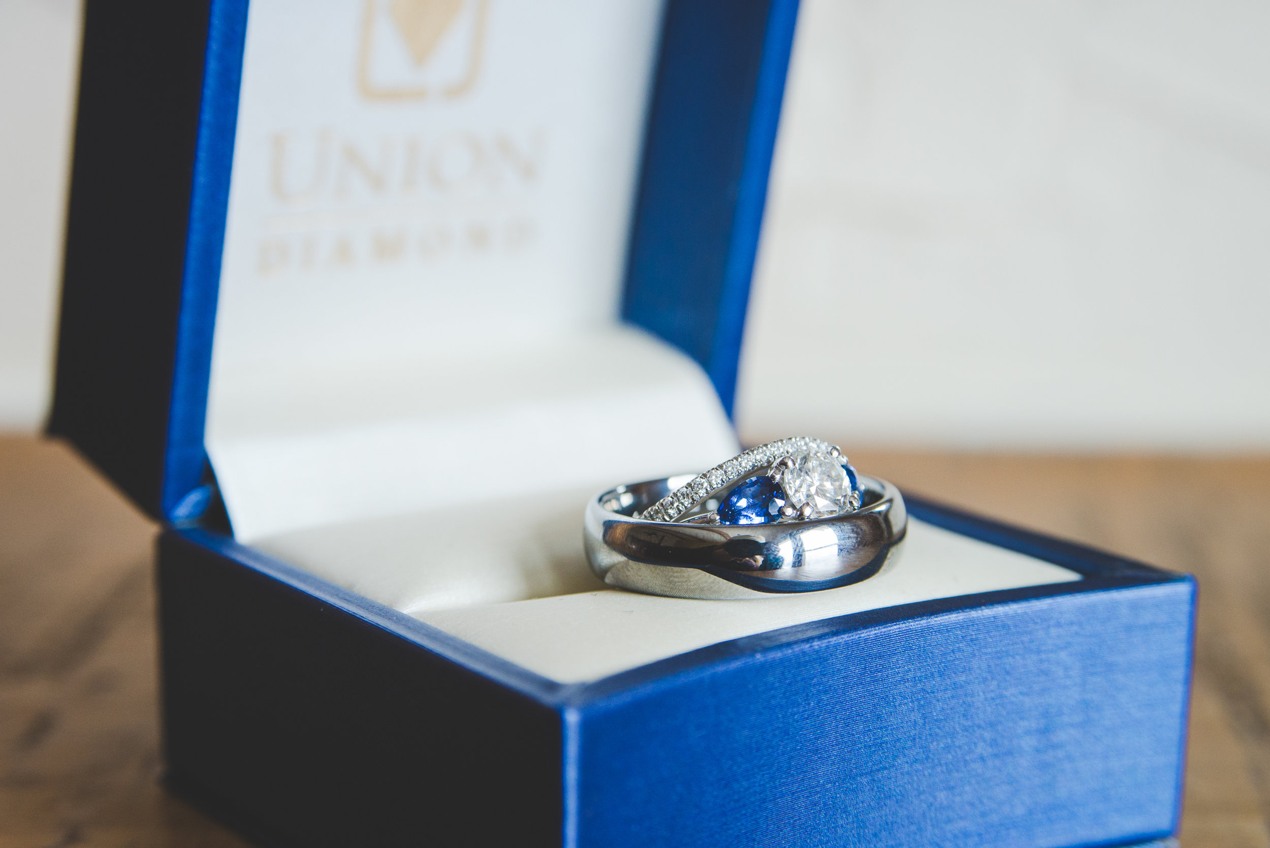 Stunning rings sit in a Union Diamond ring box for this couple's winter colorado wedding | photo by keeping composure photography