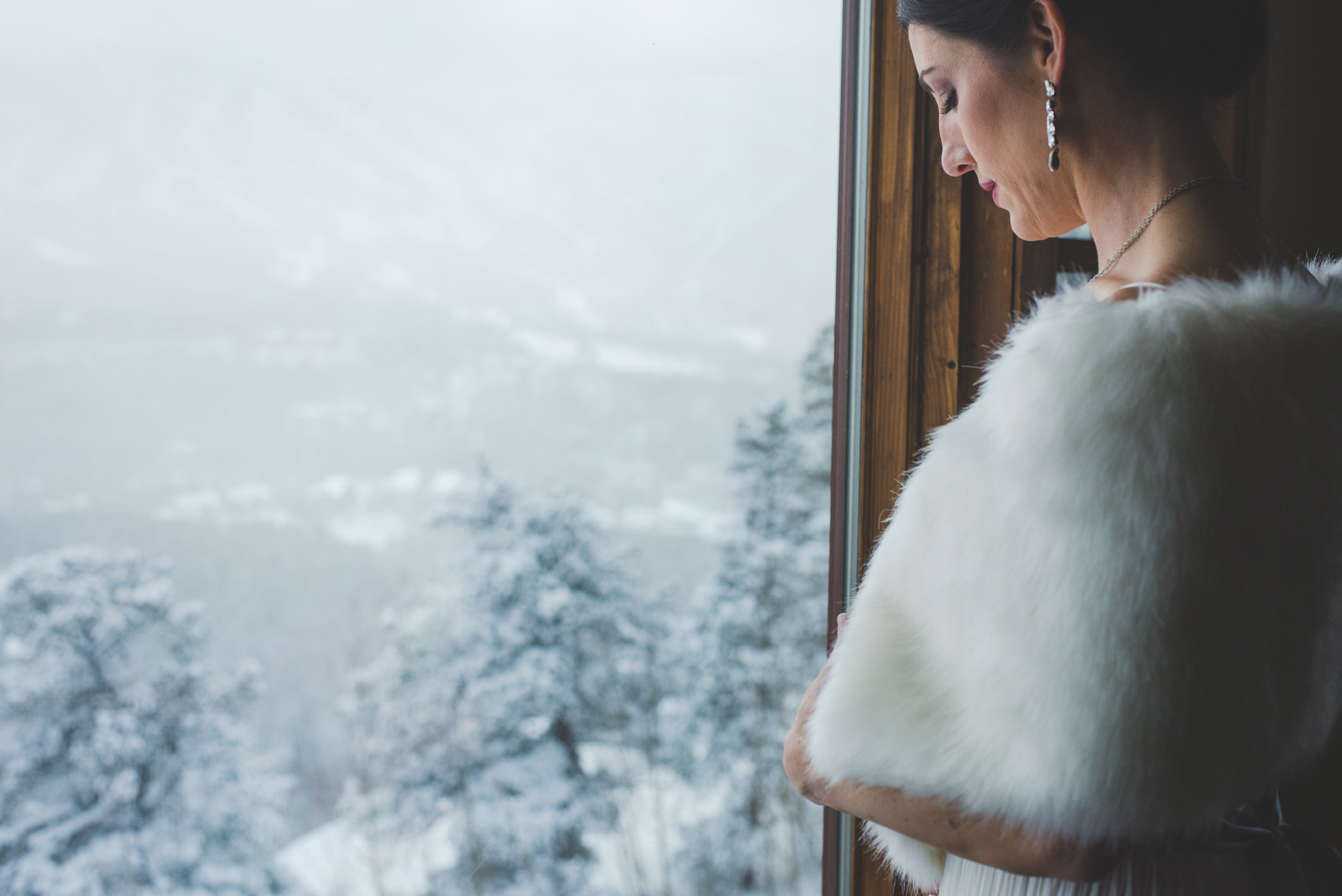 destination bride gets ready with her final touches before a snowy, beautiful winter colorado elopement in BReckenridge. | photo by keeping composure photography