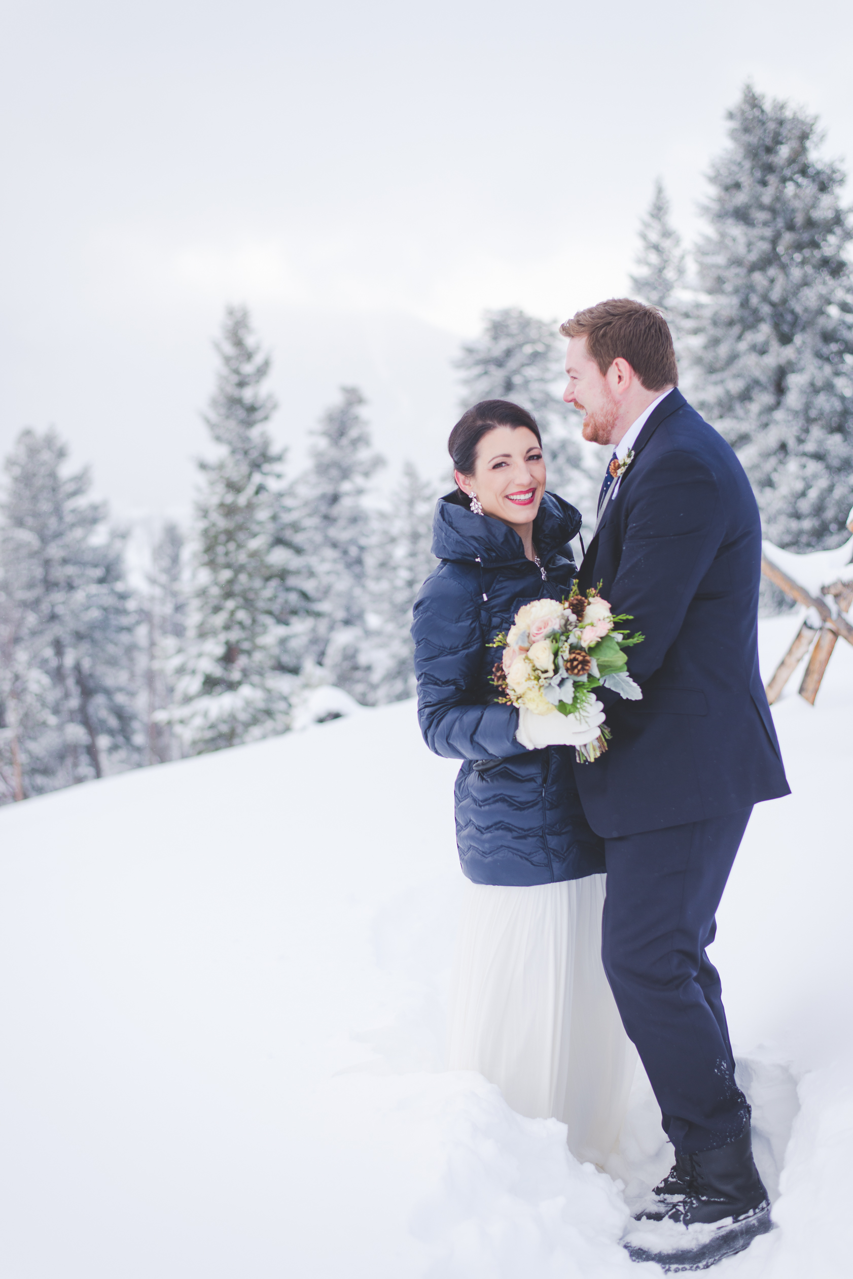 the snow was deep and smiles endless at sapphire point after this destination couple's winter elopement in Breckenridge, colorado. | photo by keeping composure photography