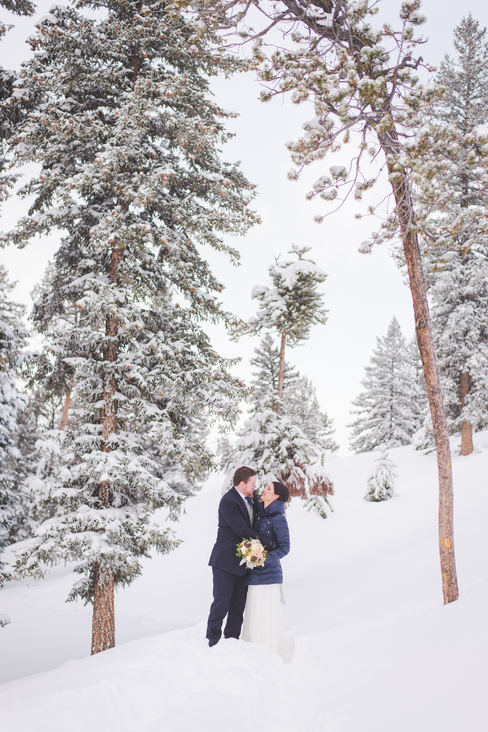 fresh snow (over a foot and a half!) decked the trees and the trail and created a magical wonderland for this destination elopement in breckenridge, colorado | photo by keeping composure photography