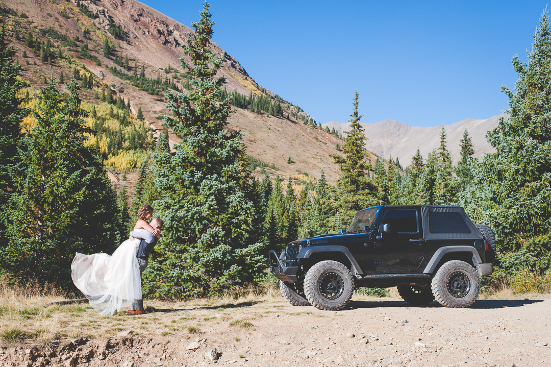 Destination wedding couple brings out their Jeep for an off-roading adventure on their wedding day, exploring the high alpine mountains in Colorado