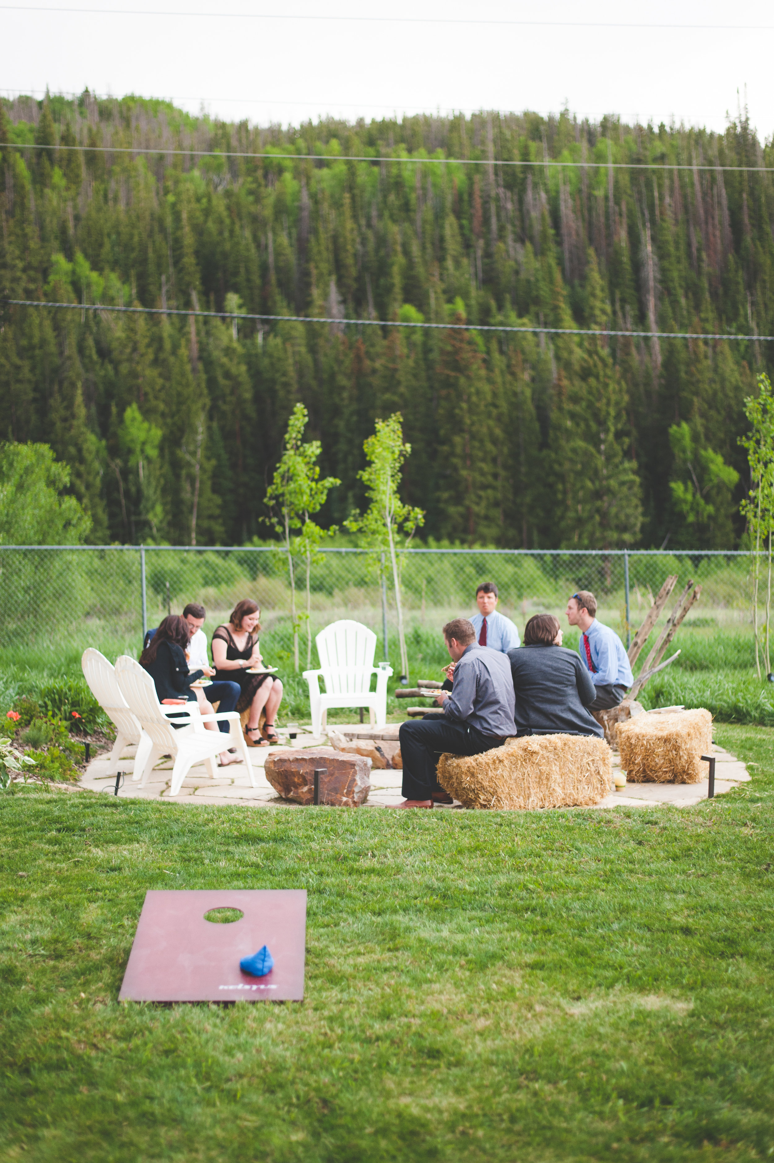 hay bales and fire pit at outdoor wedding reception