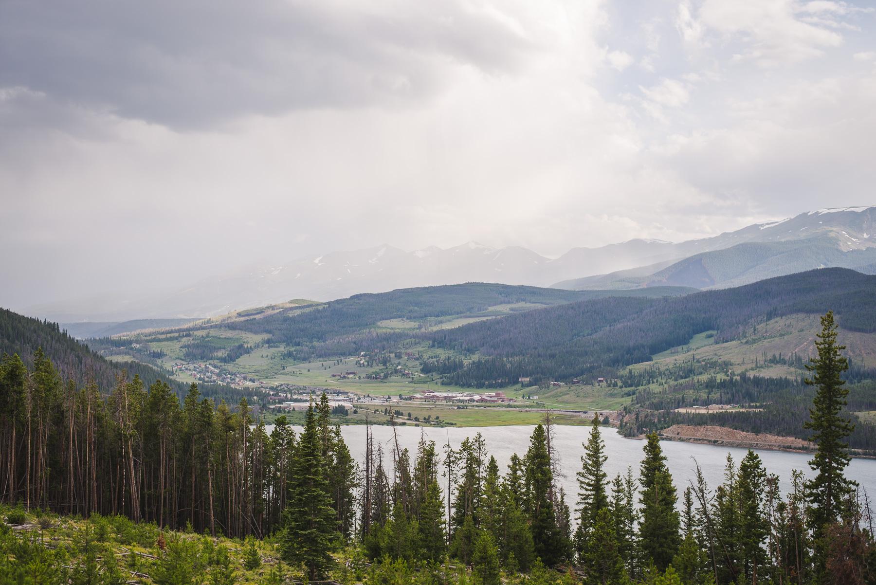 colorado bride and groom small wedding by lake dillon | summit mountain weddings | rain over breckenridge
