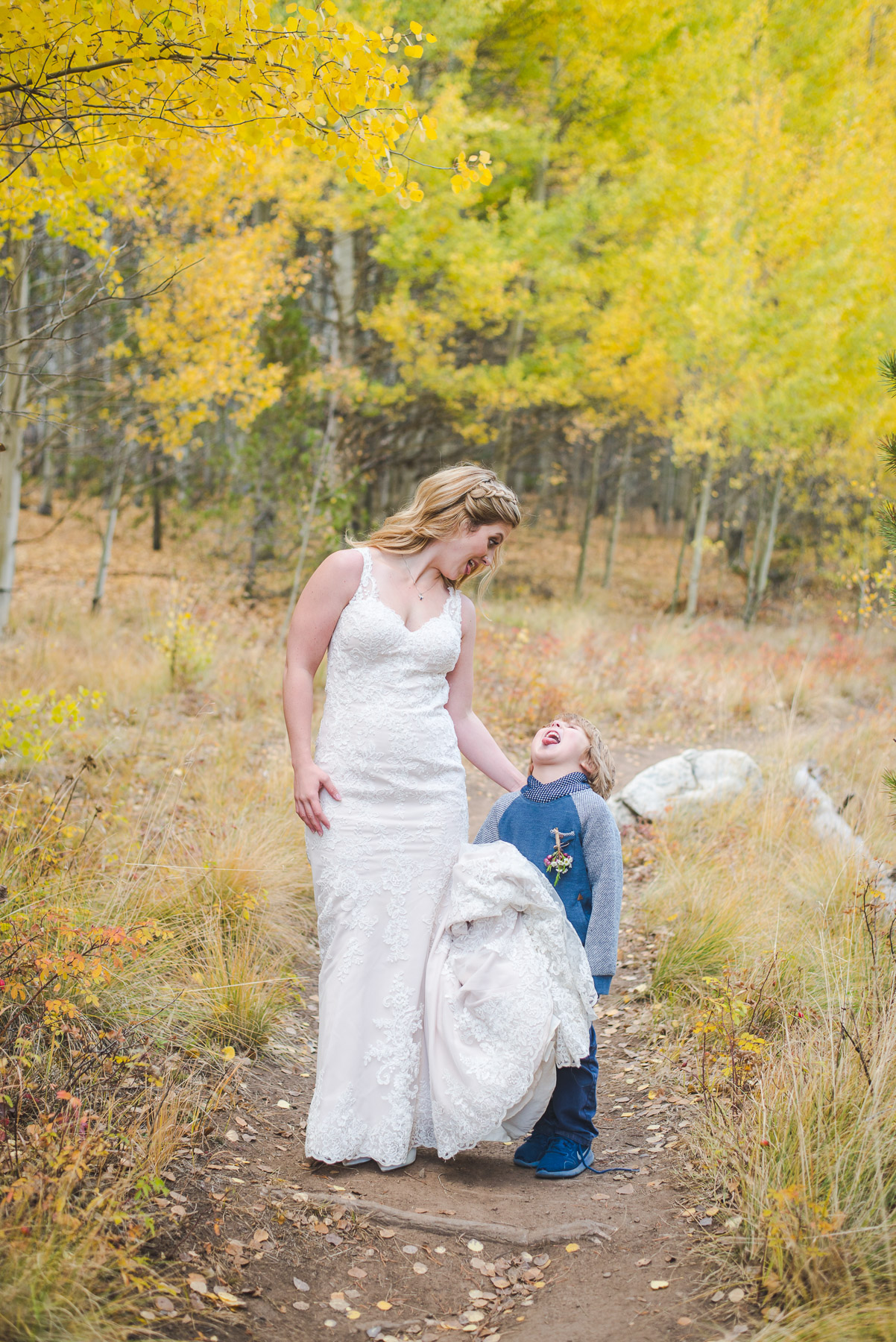 Mom bride and older brother take portraits together | Autumn elopement in Breckenridge, Colorado | Summit Mountain Weddings