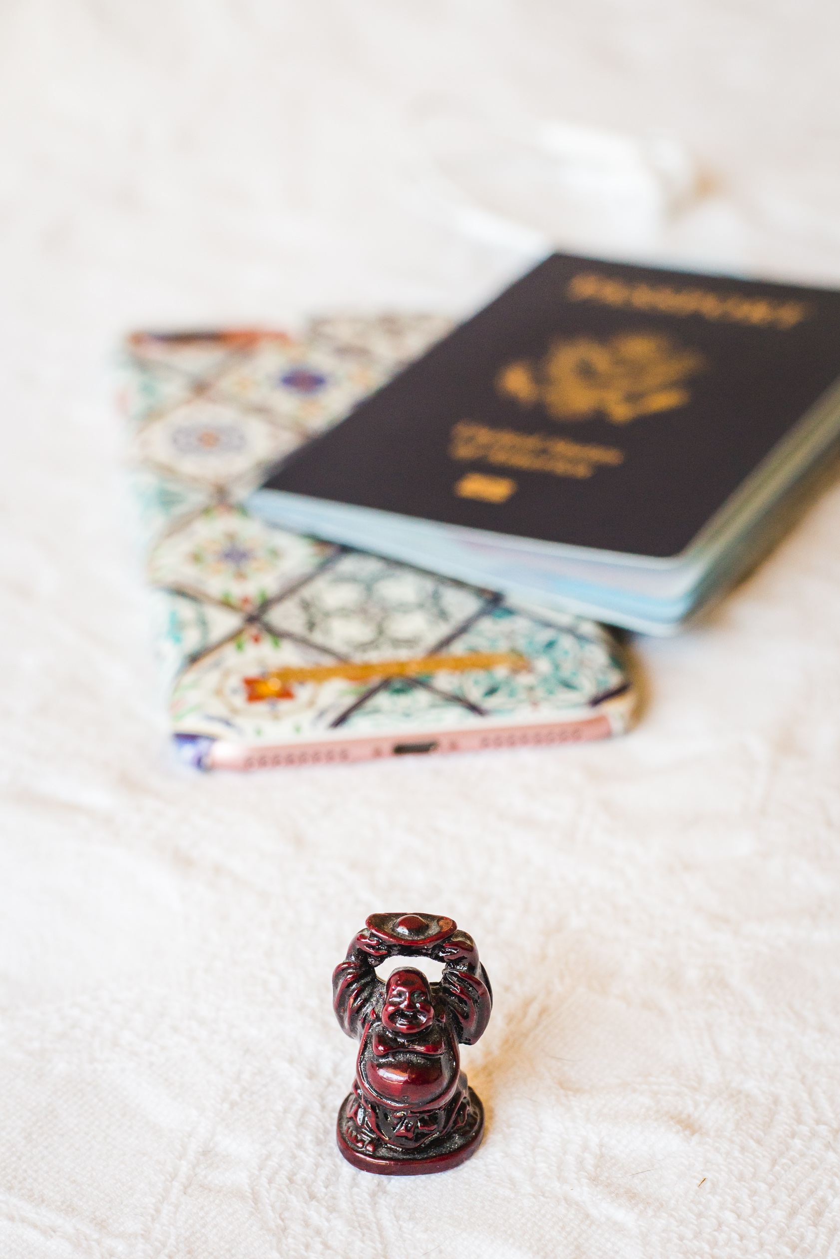 travel buddha and passport and phone | image by keeping composure photography