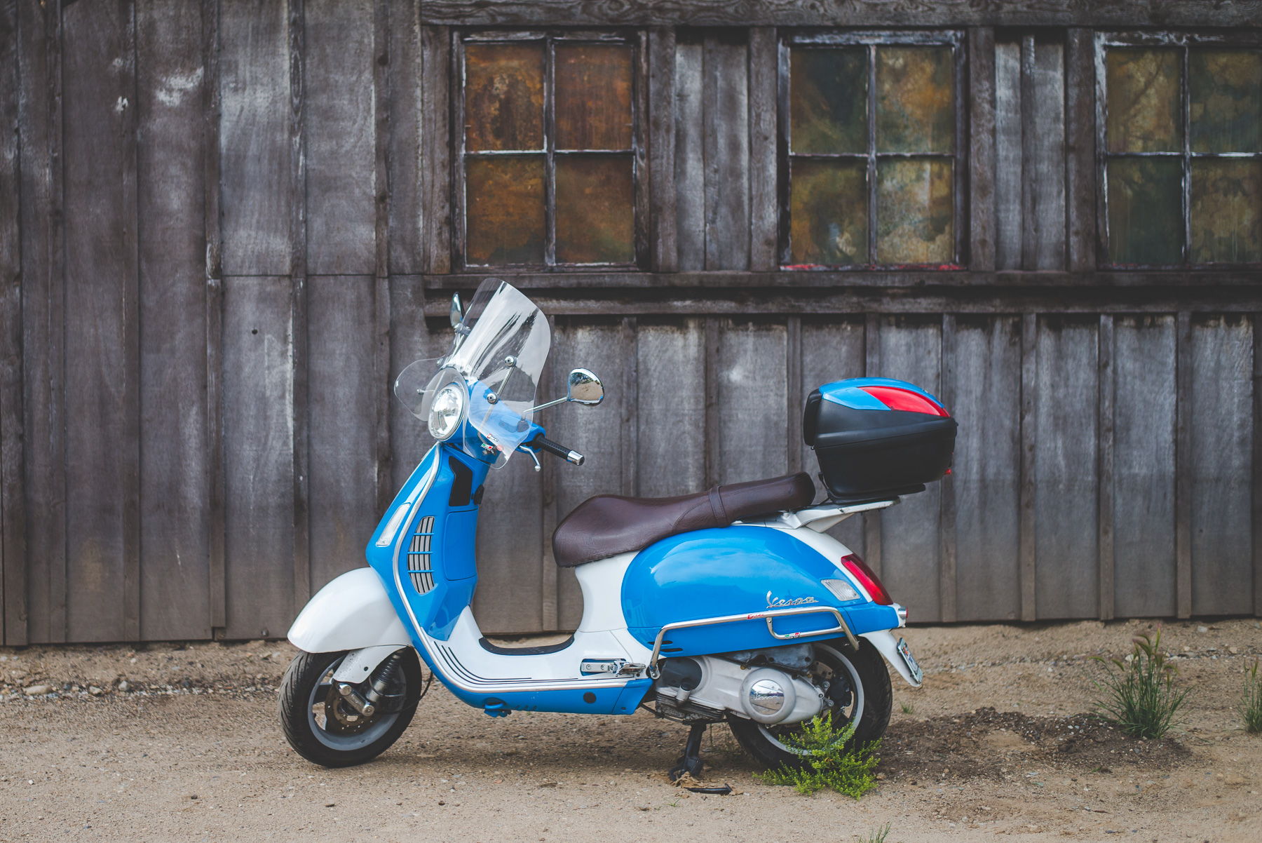 scooter near a rustic building in the Colorado mountains