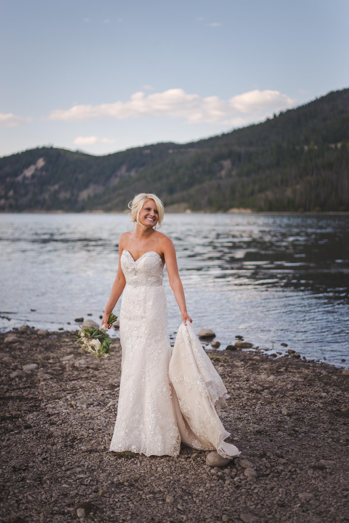 bride by lake at dusk