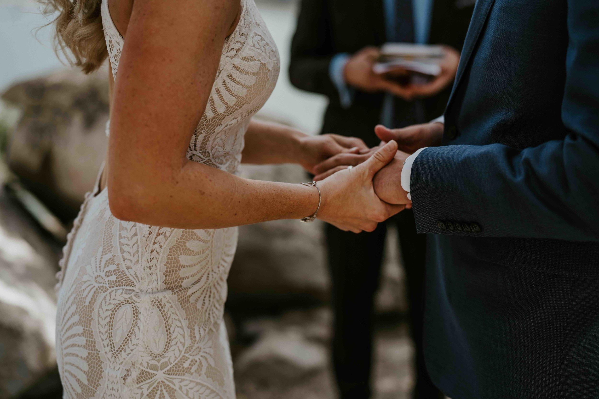 colorado bride and groom small wedding purple wildflowers   summit mountain weddings