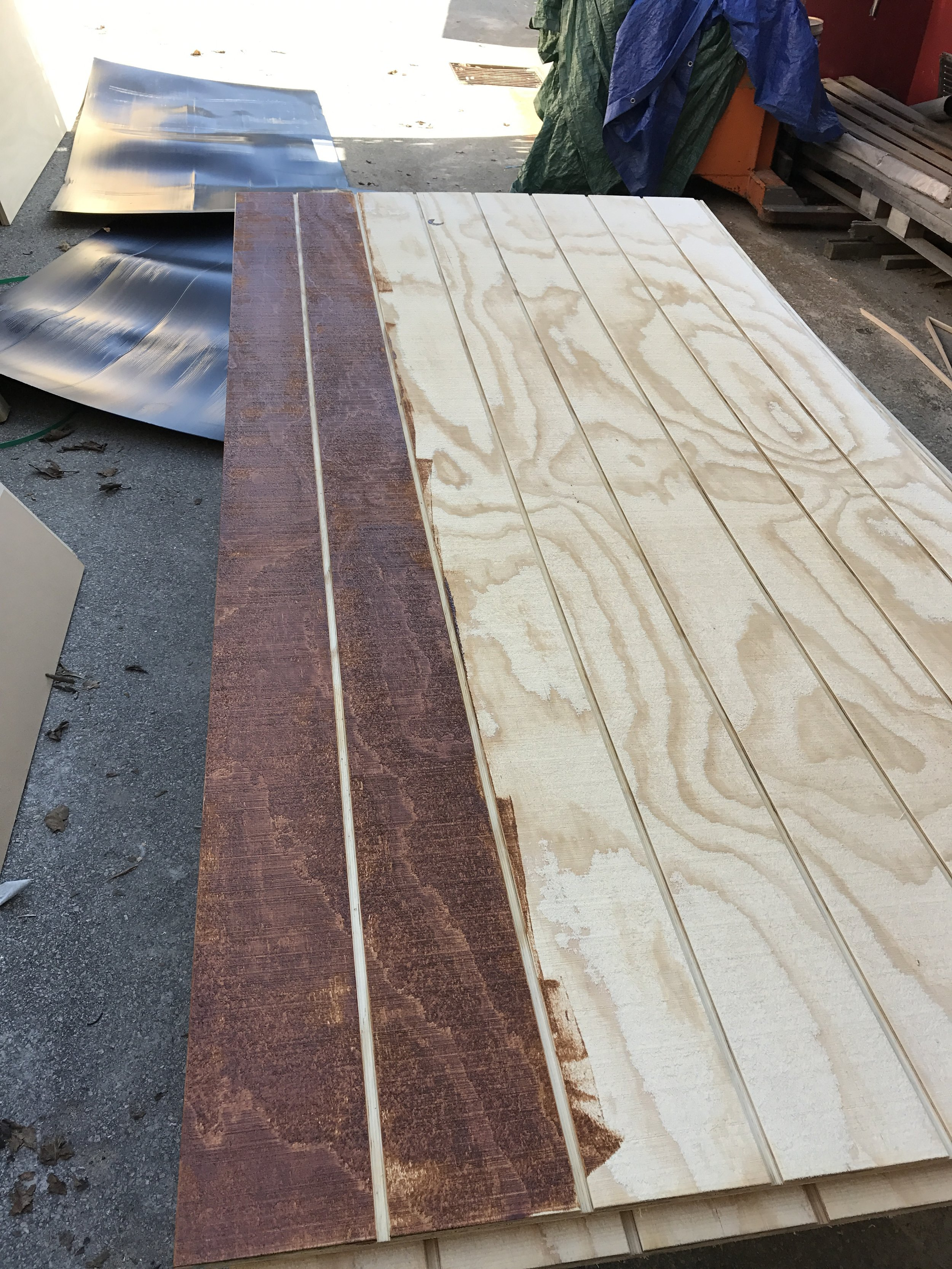 Staining the shadow clad with a teak stain