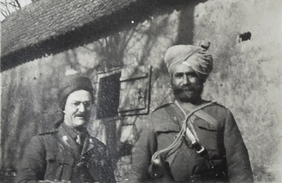 Tom in loonghi with Risaldar Major Amar Singh in Thérouanne, January 1915.  © Westmacott Family Archive