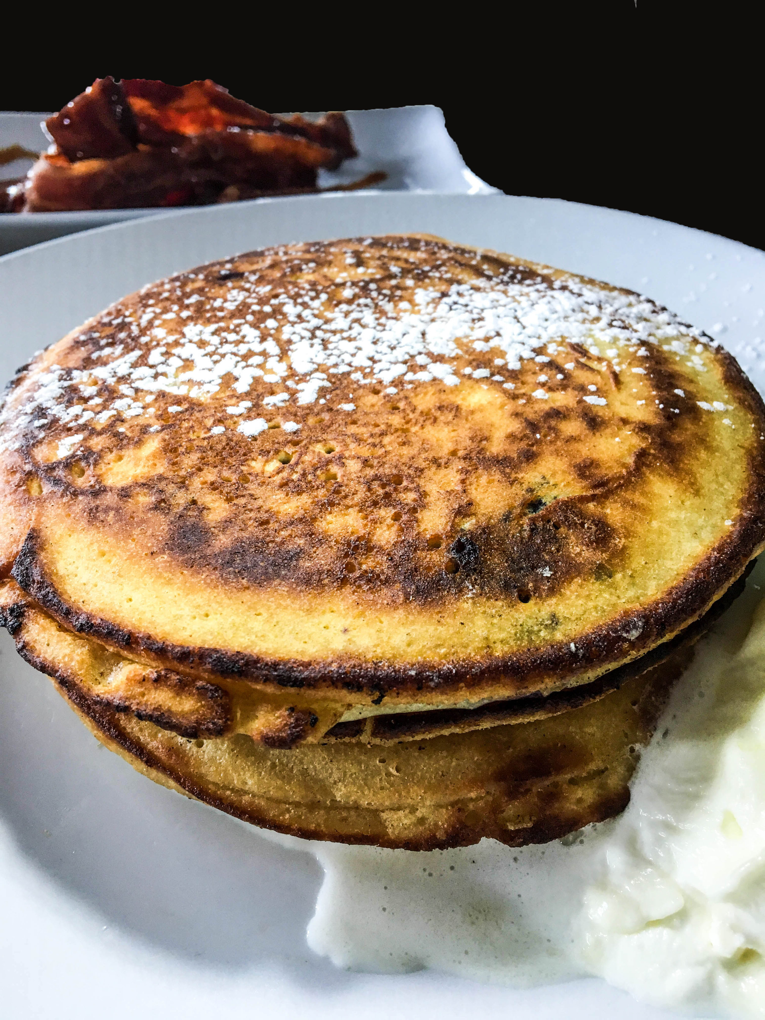Blueberry & Ricotta Corn Cakes - Cornmeal and ricotta pancakes with blueberries, thyme, lemon zest,served with fresh ricotta.  Side order of Bourbon Glazed Bacon.