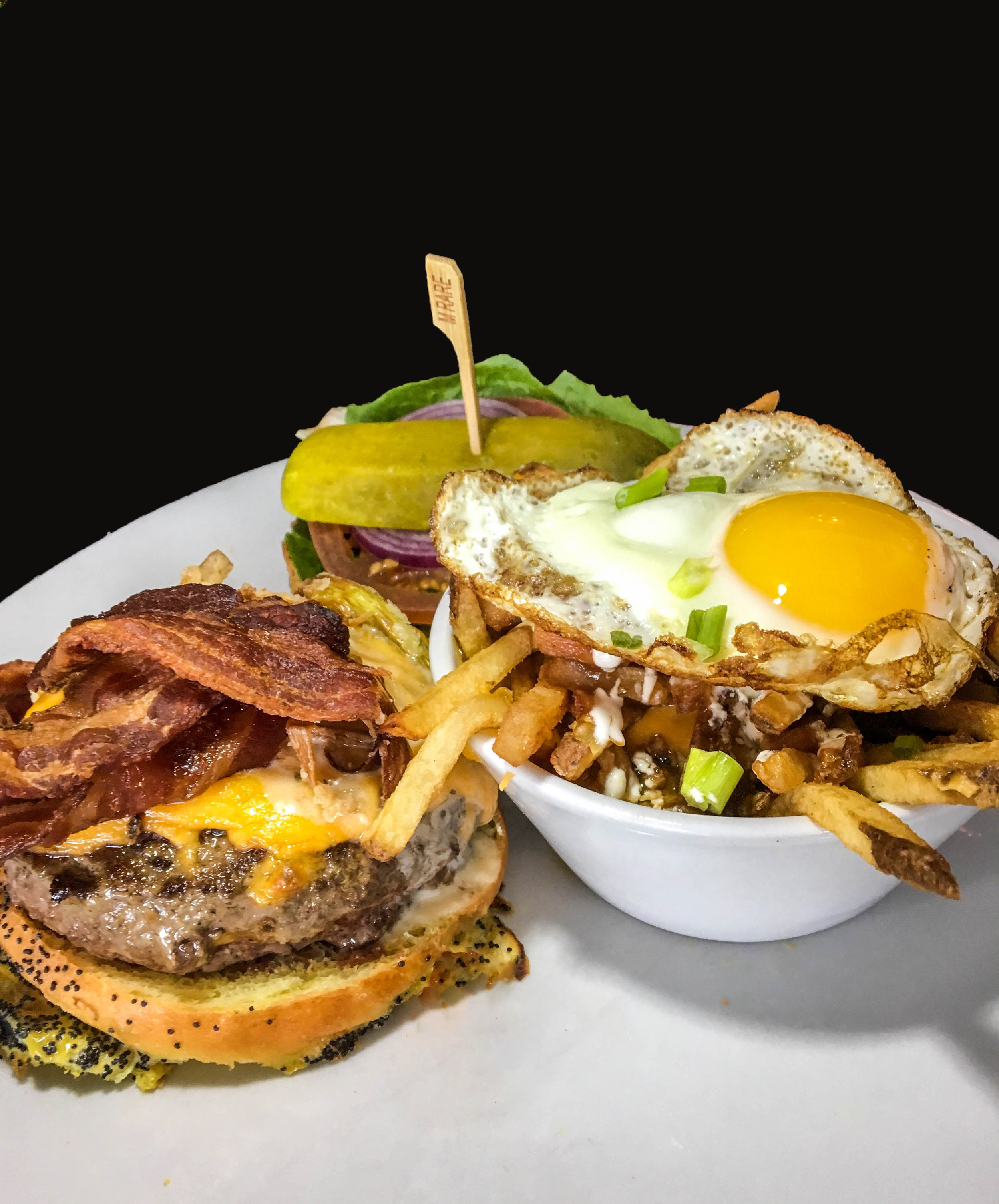 Redemption Burger - Ground short rib & brisket, applewood bacon, smoked cheddar, crispy shallots, redemption bourbon sauce, on a poppy-onion roll.  Side order of BrewFrites - Hand cut fries, hickory-smoked cheddar, beer braised pork belly, fried egg, gravy and crème fraiche.