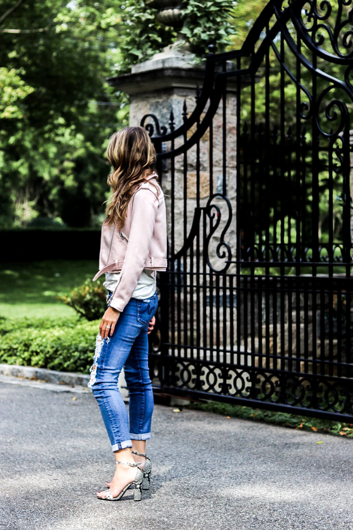 zara pink suede jacket and distressed jeans