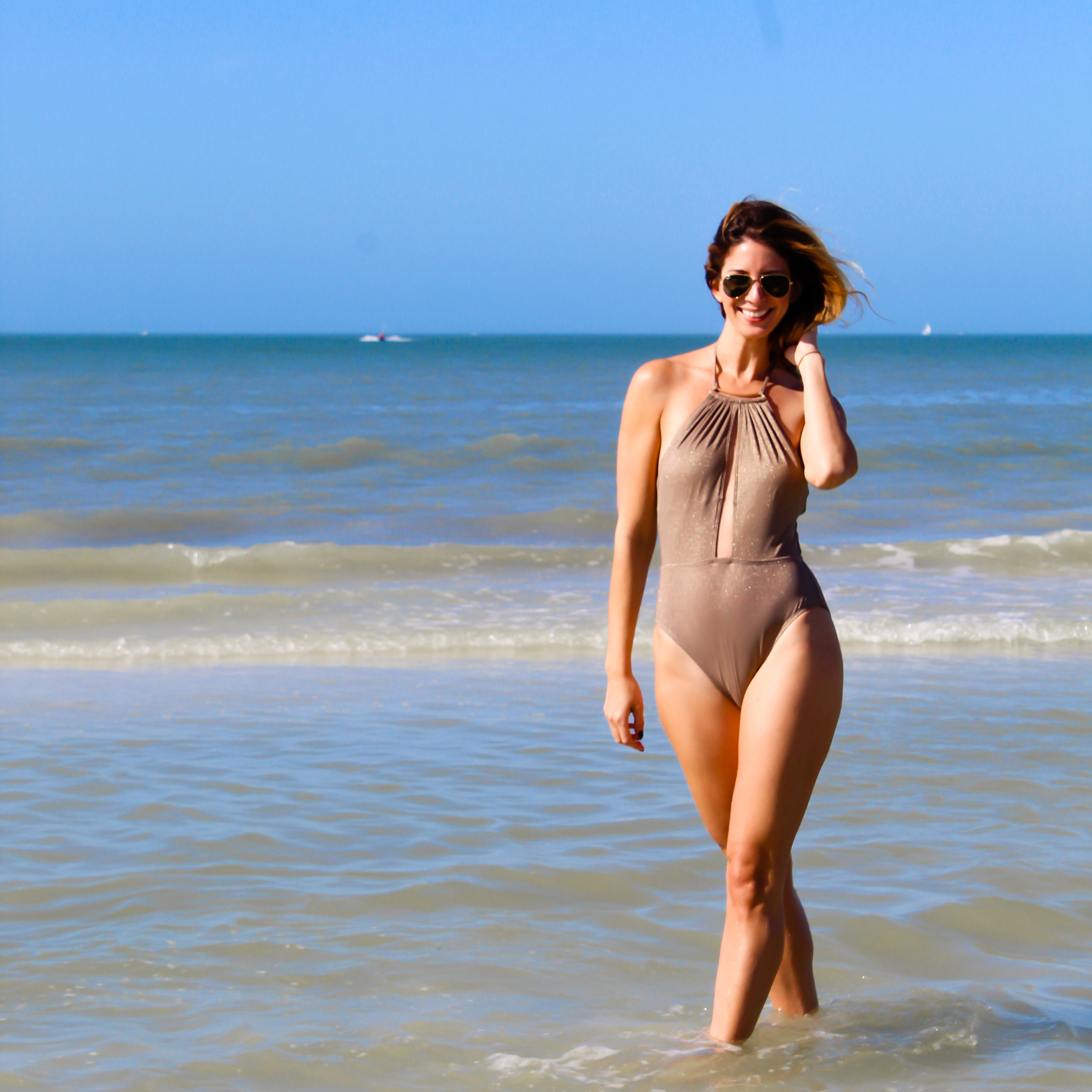 Swimsuit:  Kenneth Cole  Sunglasses:  Ray Ban