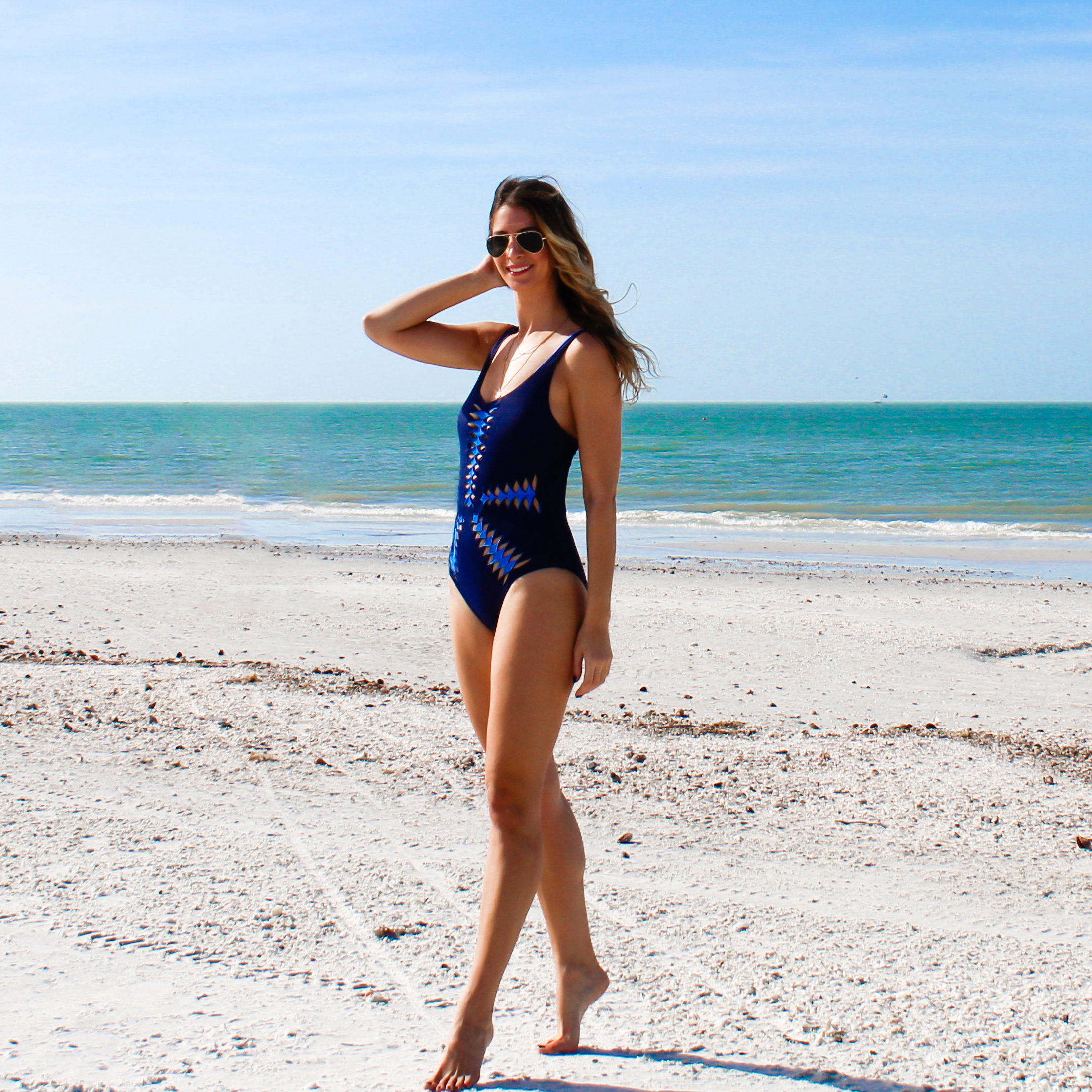 Swimsuit:  Becca  Sunglasses:  Ray Ban
