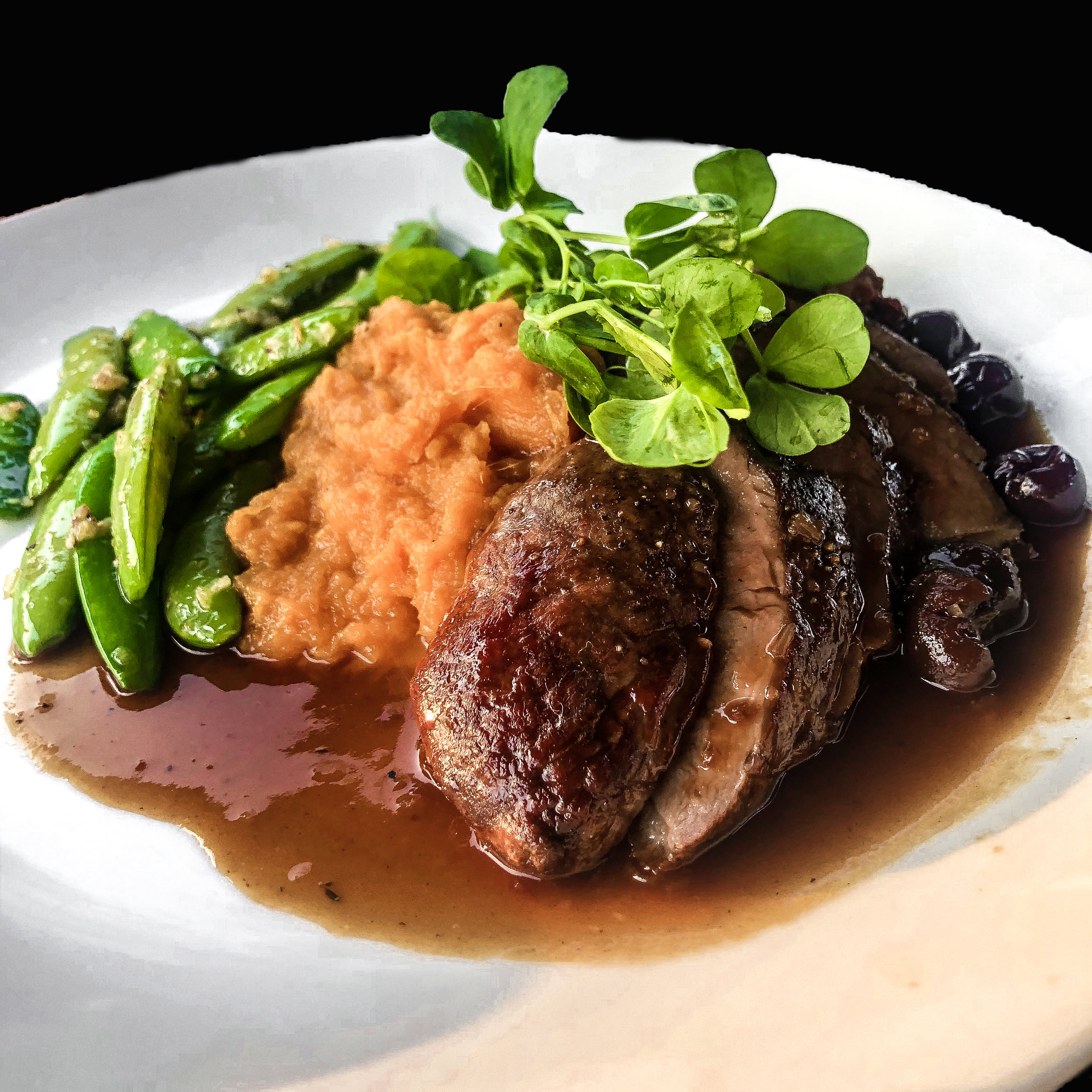 crescent farms duck breast   port wine cherry sauce, sugar snap peas, sweet potato puree