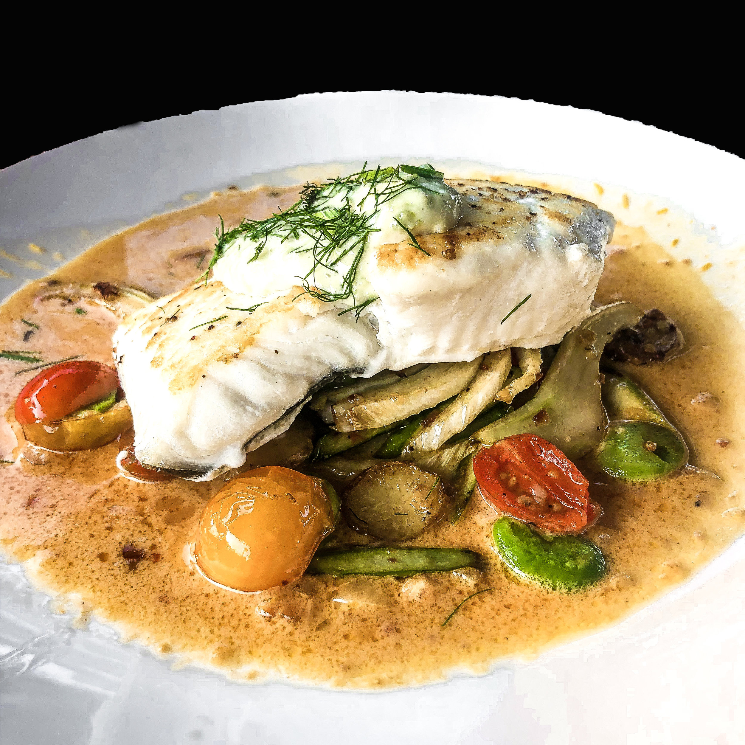 pan seared halibut   roast fingerling coins, cherry tomato, asparagus, fennel, lima beans, citrus nage, olive aioli
