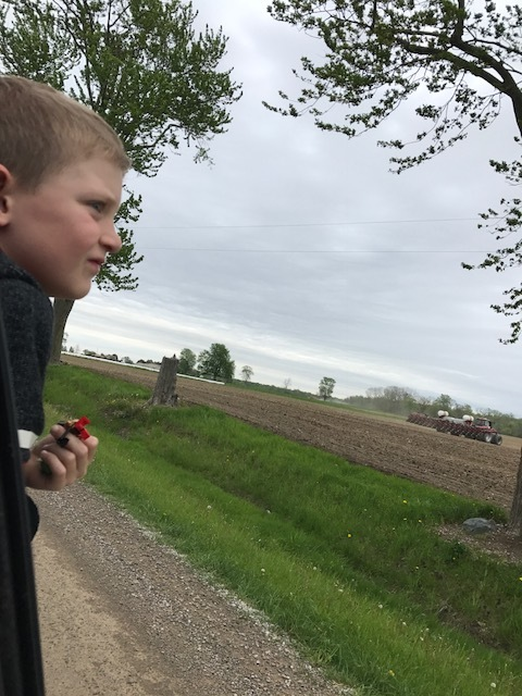 The boys love watching the equipment in the field at this time of the year!  Mason is enjoying watching Robson Bros big corn planter planting our corn, and Daddy and Papa cultivating the land ahead of the planter.   Lot's to see in one field!