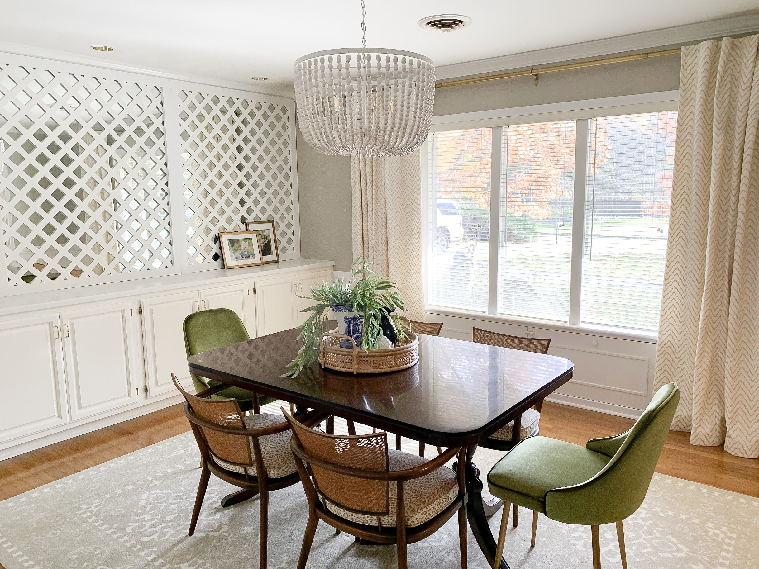 midcentury modern dining room with white beaded chandelier