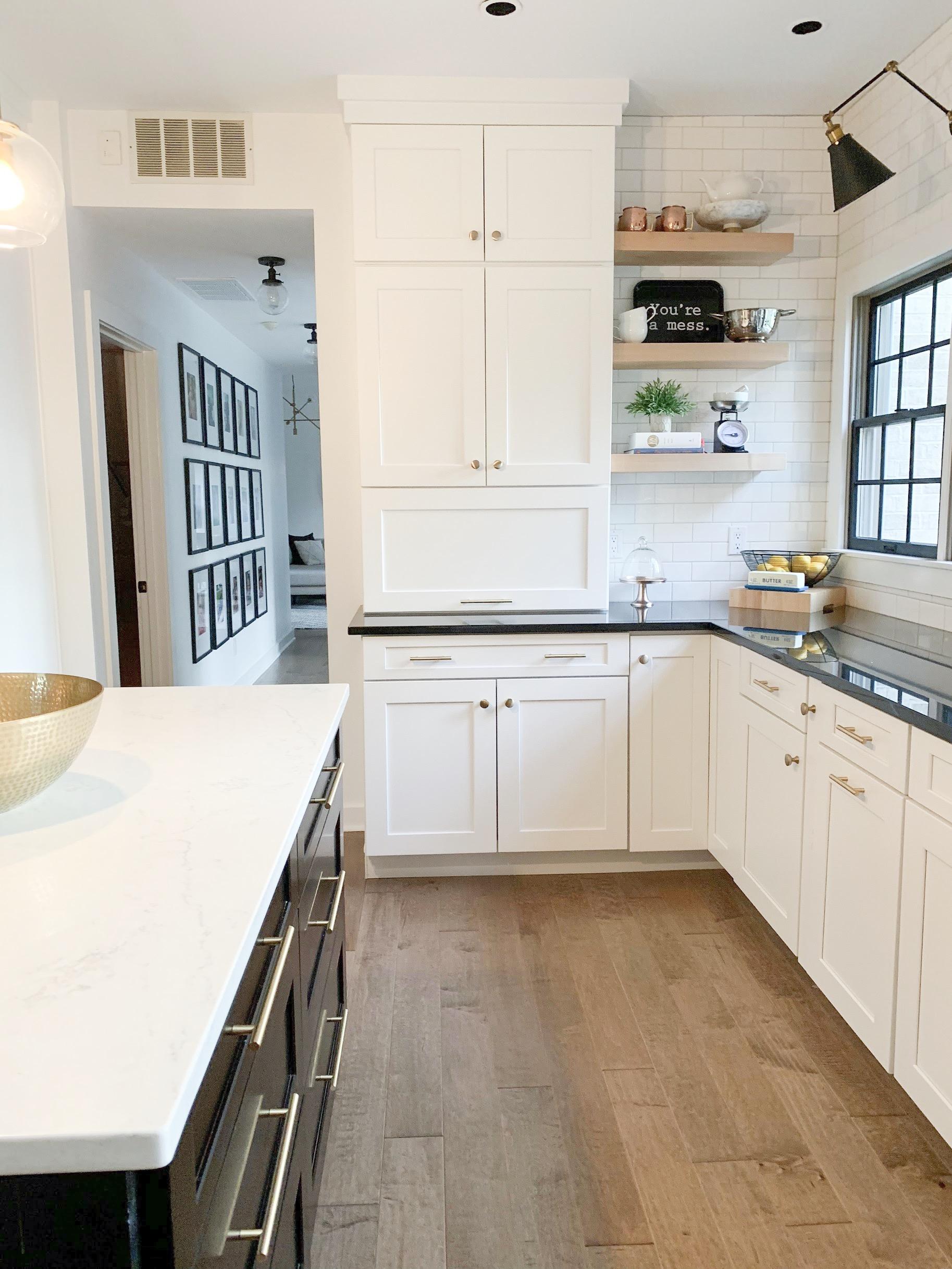 modern white kitchen with white subway tile
