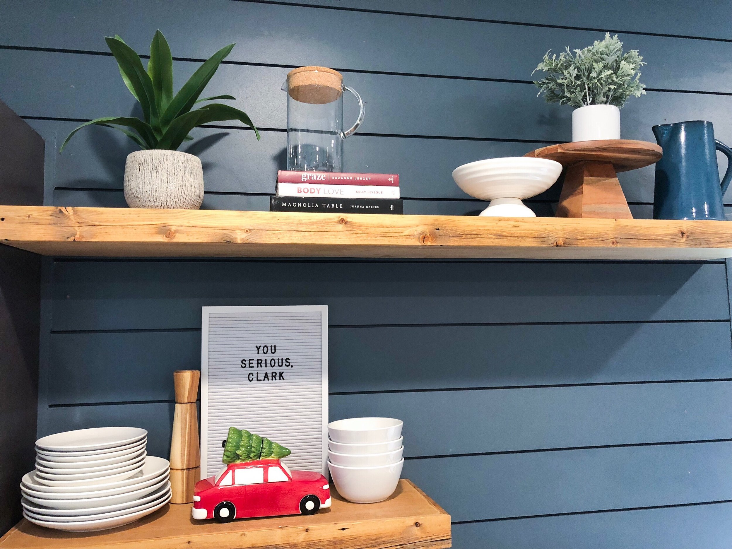 navy ship lap kitchen wall with floating shelves