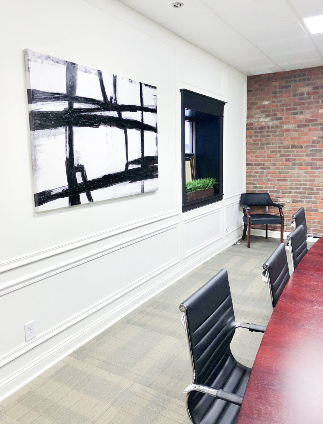 modern office with conference table and black chairs