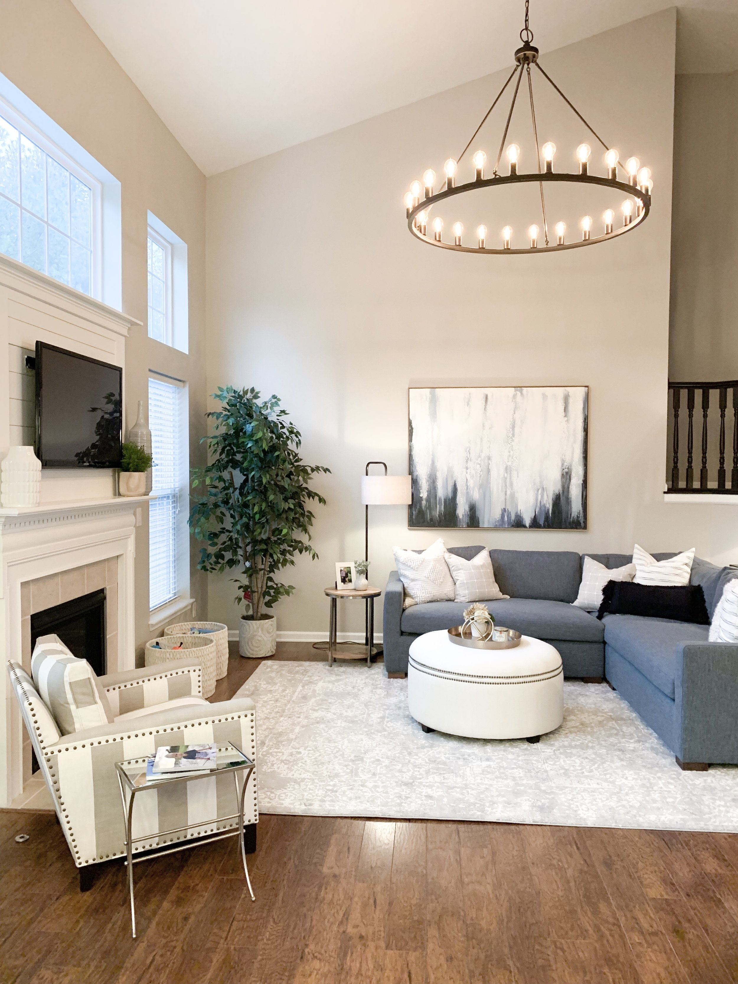 large round chandelier navy and white living room