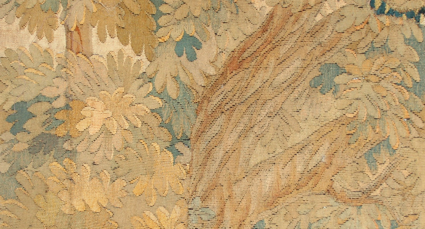 A sumptuous tapestry hanging made out of several pieces sewn together.It gives the impression of stepping deep into a leafy glade.