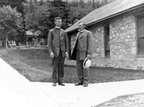 Clergy standing outside St. John's in the early 20th century.