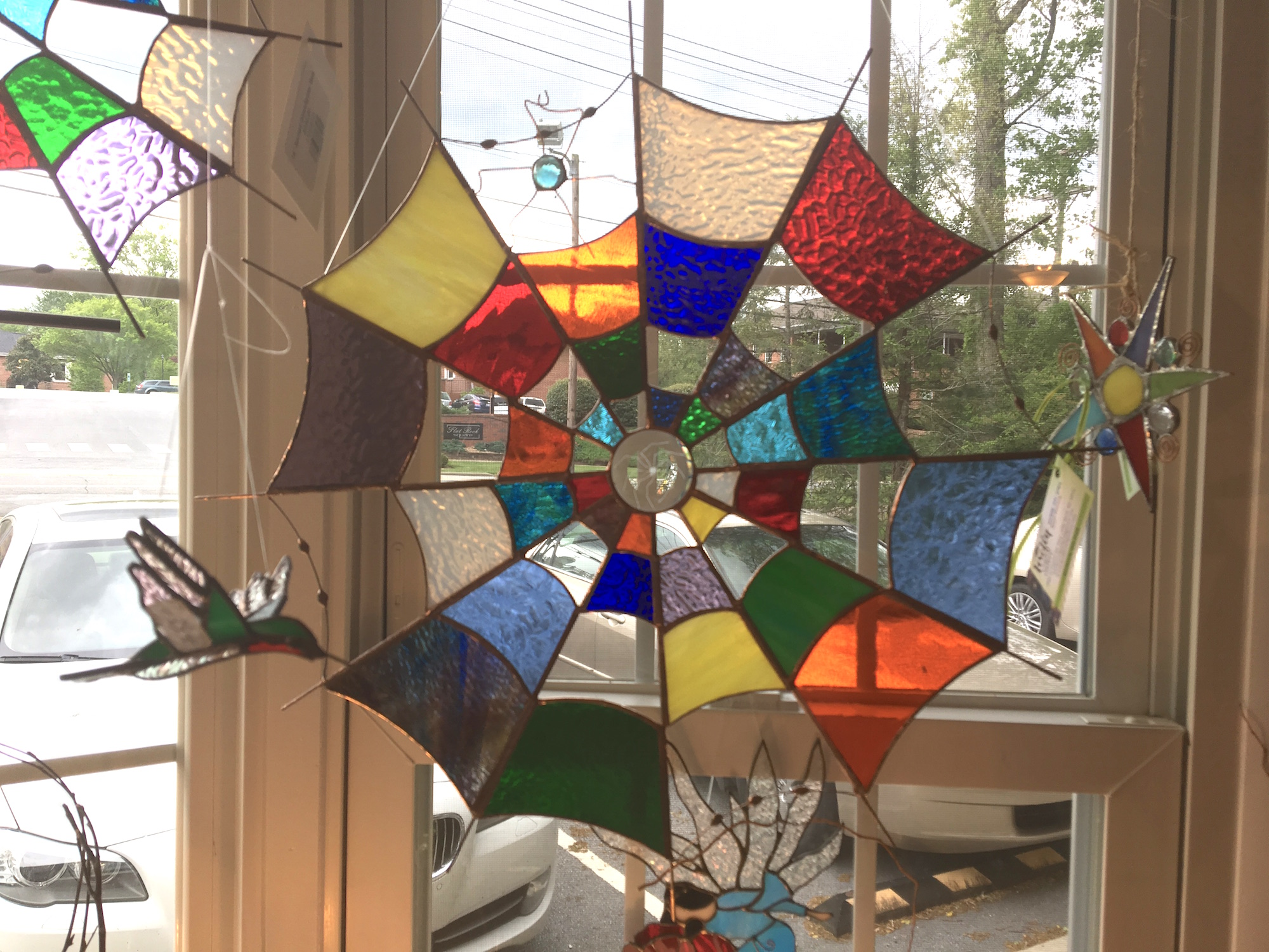 Stained glass spider web is perfect for any window!
