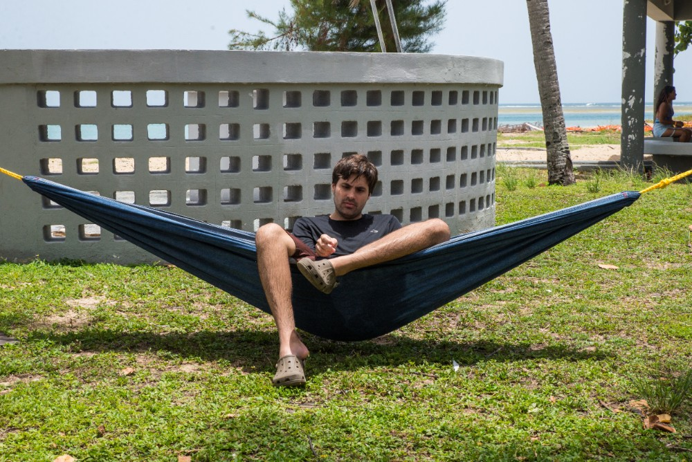 A Camp MAVI client rests in a hammock during an outing to Luquillo Beach.