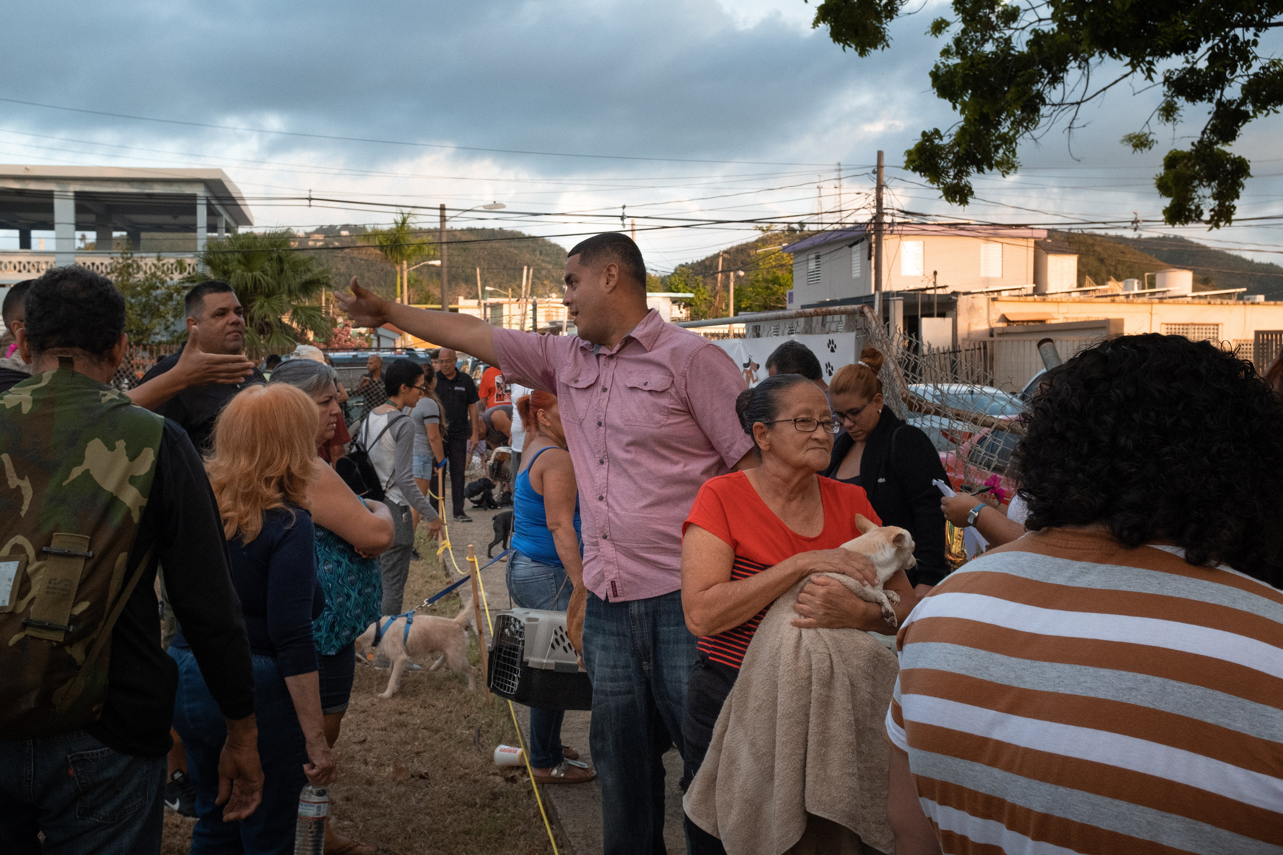 Line outside clinic at sunrise, Ceiba