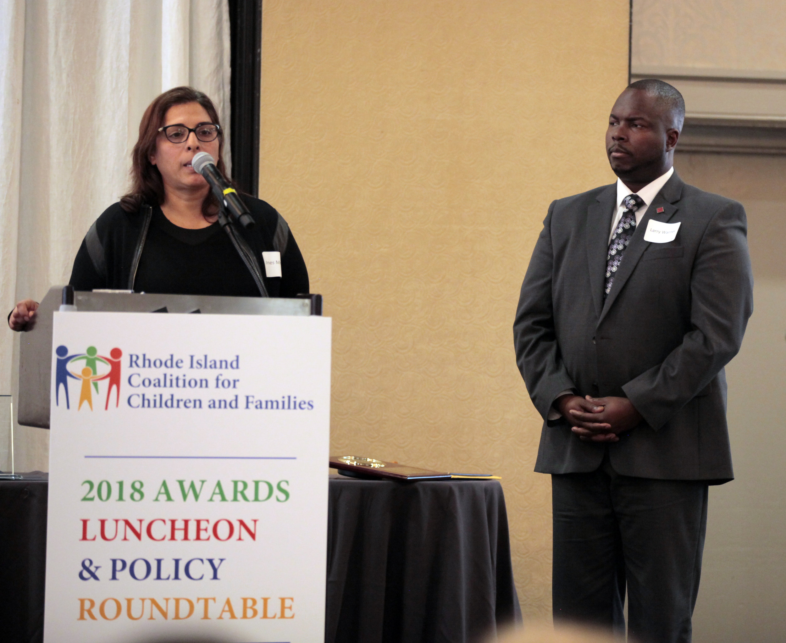 Inés Merchan  and  Larry Warner  of the RI Foundation accepting the Coalition Building award on behalf of  Neil D. Steinberg,  President & CEO.
