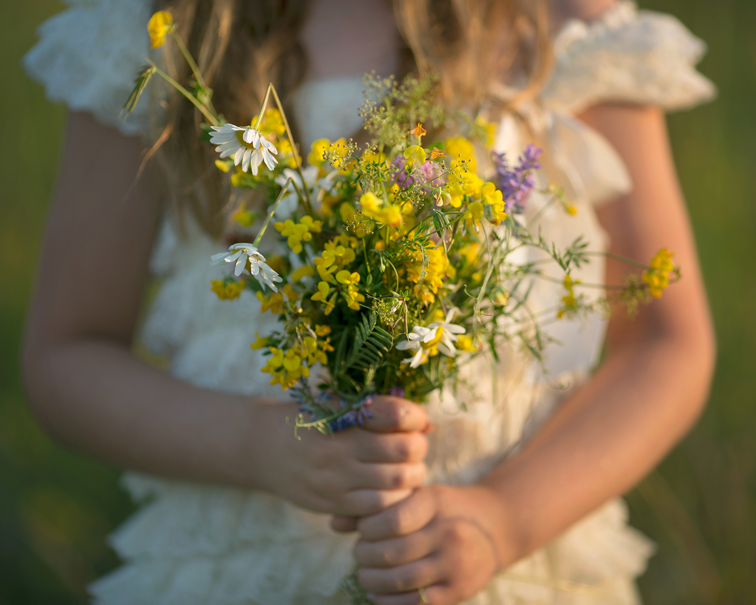 abby holds wildflowers sRGB.jpg