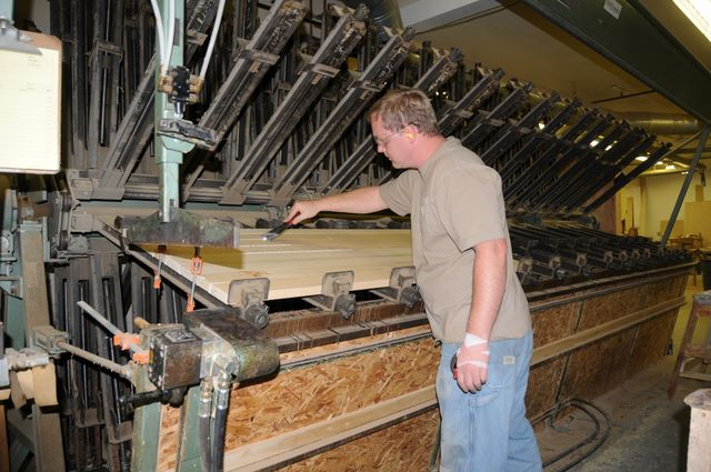 DOUCETTE 16' X 16' SECTION CLAMP CARRIER  This machine was custom made for us in Montreal. It allows for continuous glue- ups of wide panels, doors, or handrail blanks up to 16 feet in length.