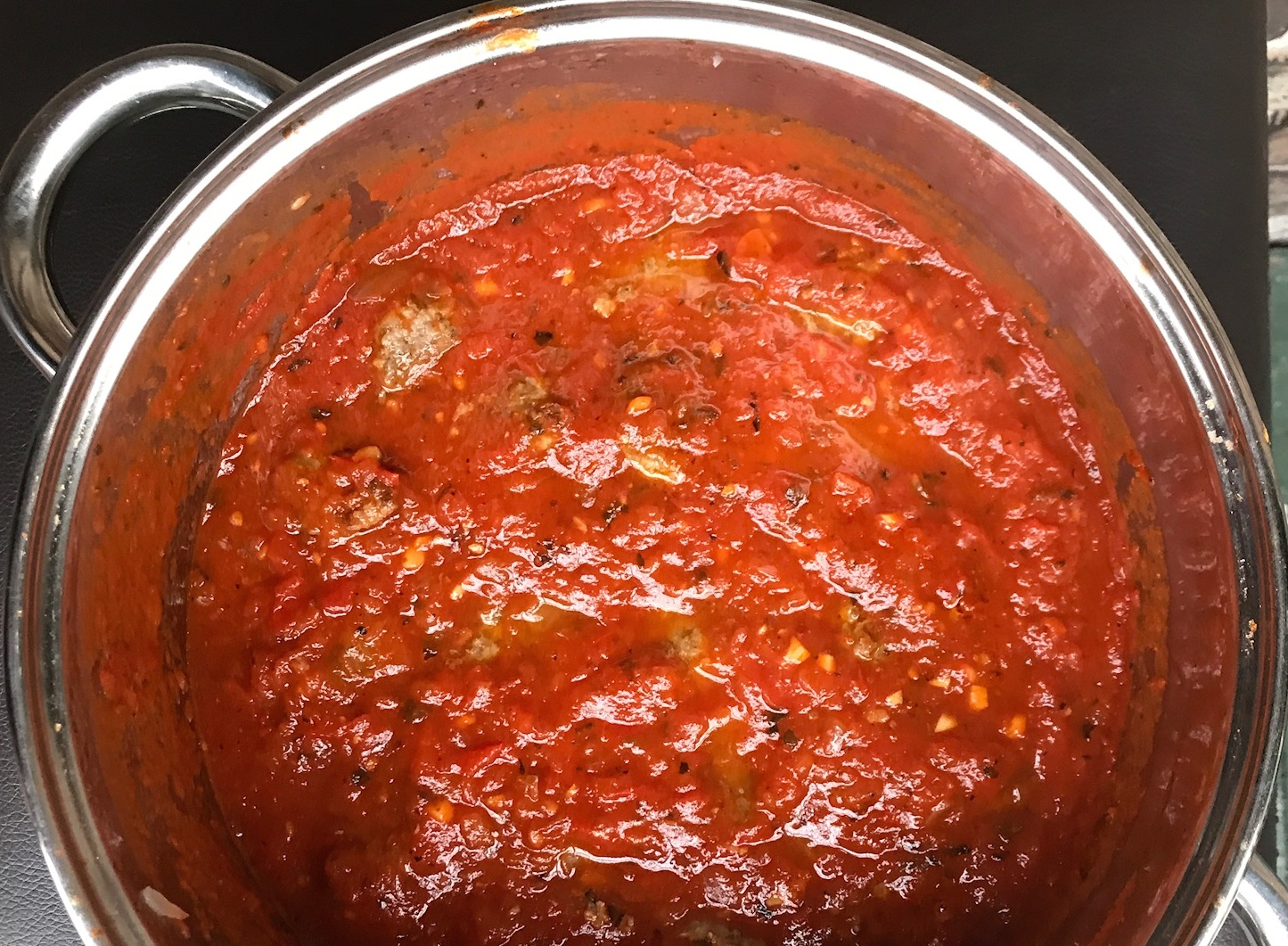 - Let the tomato mixture cook for 15-20 minutes, or until the crushed tomatoes begin to break down. Add the salt, pepper, sugar, basil, oregano, and Italian seasonings, cover,and allow to simmer on low heat for an additional 1.5 to 2 hours. Stir occasionally.