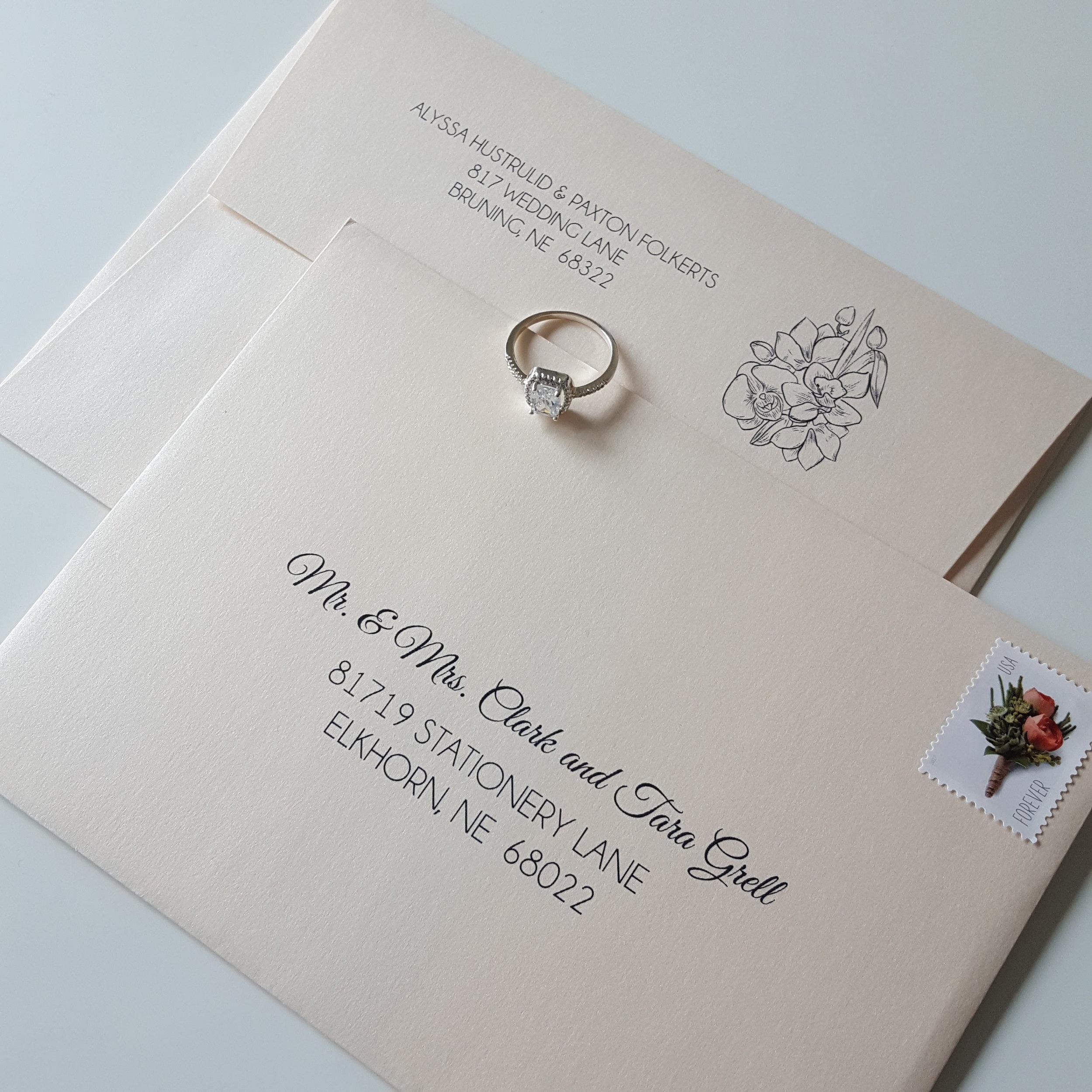 blush envelopes with navy addressing