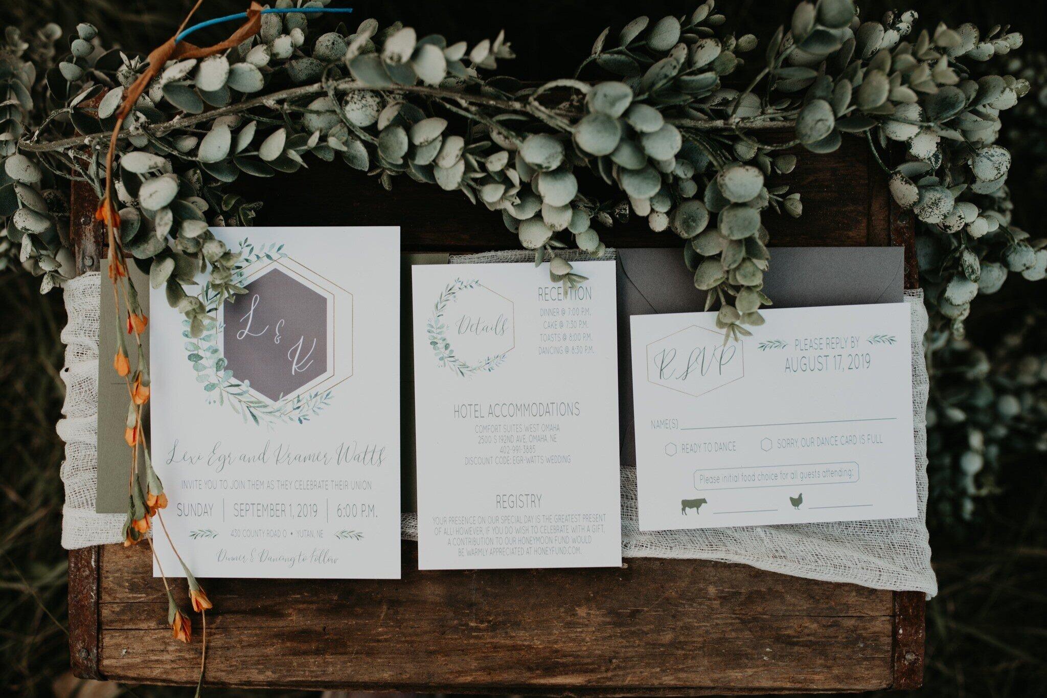 gold hexagons and greenery wedding invitation