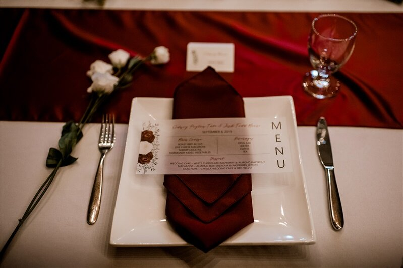 burgundy and ivory watercolor flowers with greenery vellum wedding menu and place card