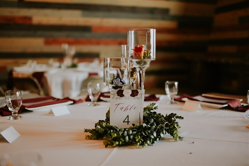 burgundy and ivory watercolor flowers with greenery wedding table number