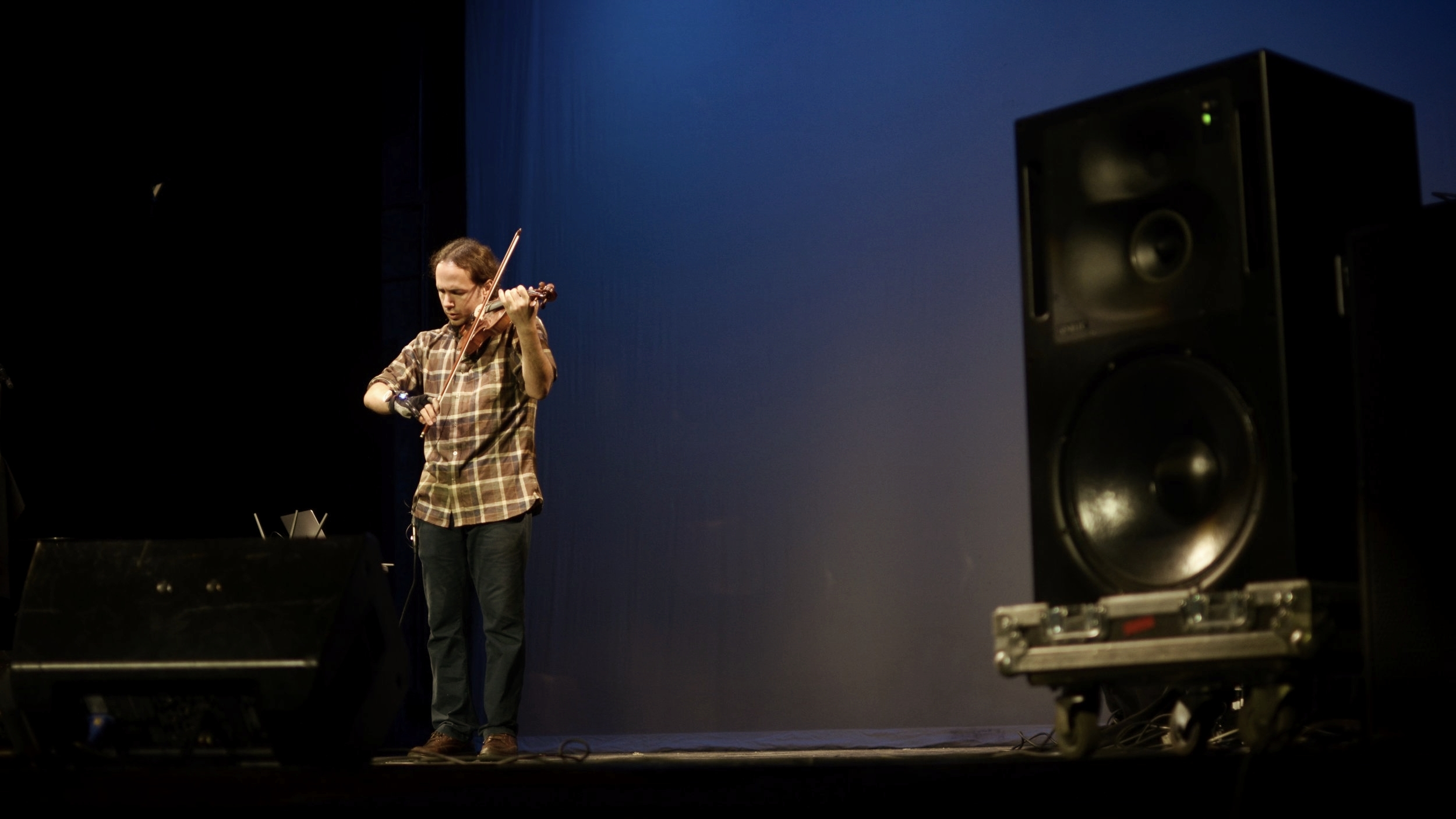 Performing on violin.  New York City Electroacoustic Music Festival.